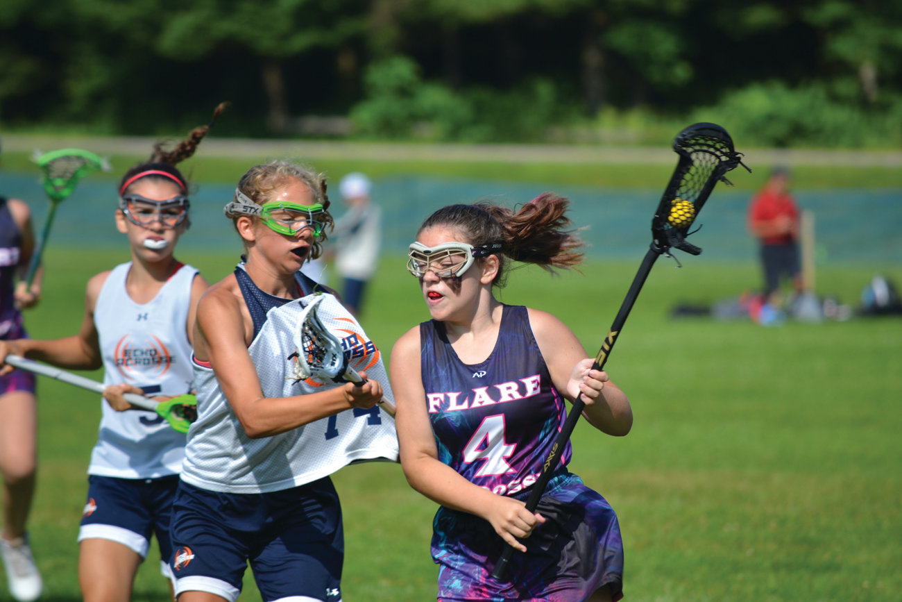RUNNING WITH IT: A member of the Flare Lacrosse team carries the ball during a game. The team will travel to Maryland, New Jersey and New York to compete during the coming fall season.