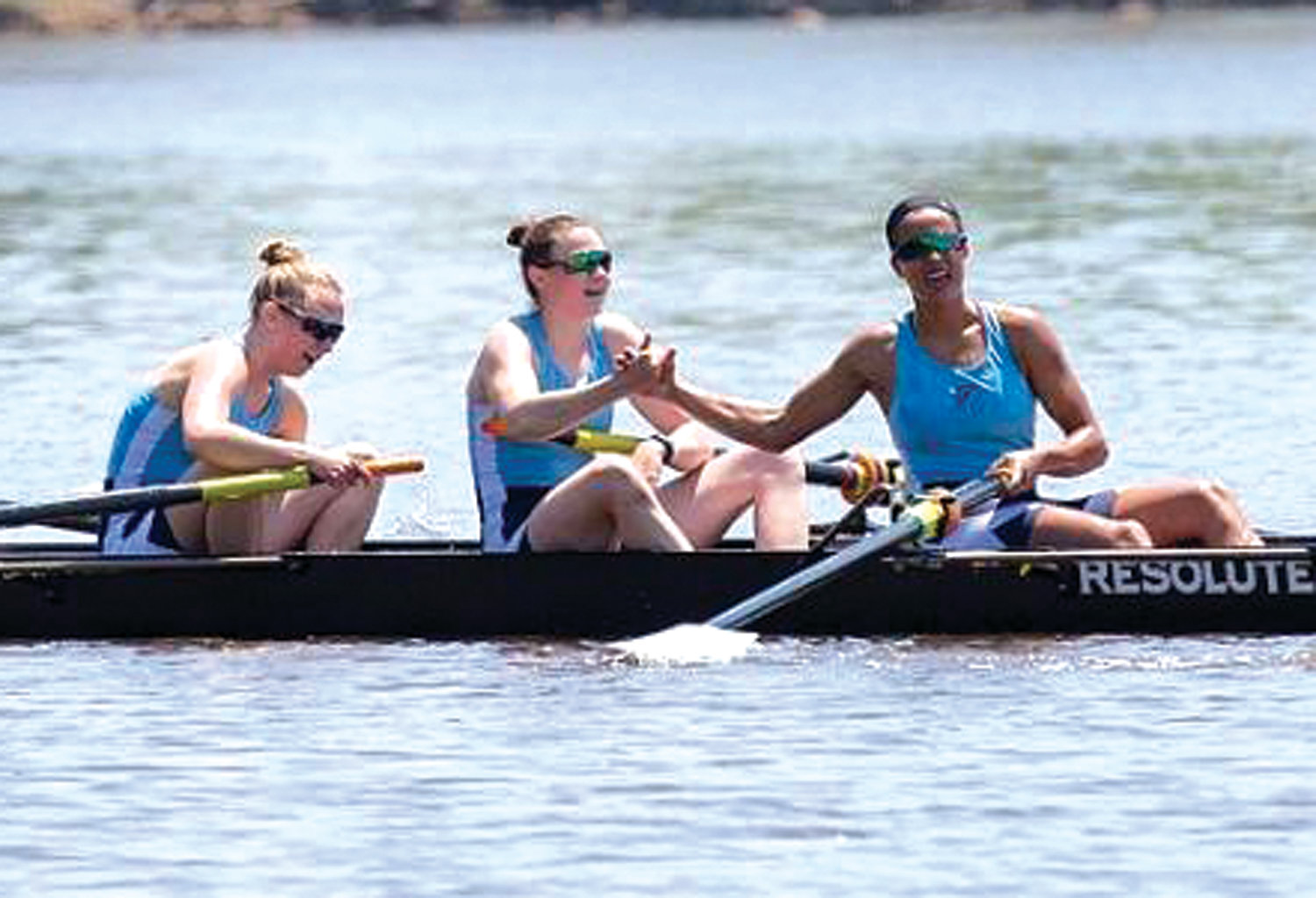 ON THE WATER: Members of the URI women's crew team, including Erika Pena (far right) compete during this past season.