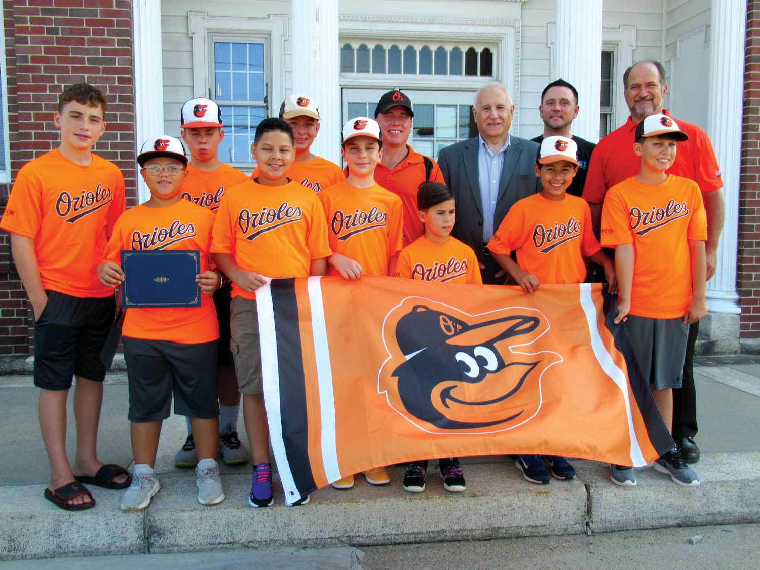 BIRD'S BANNER: Members of the Lisi Construction/Lions Club sponsored squad that recently staked claim to the Johnston Little League's prestigious 2019 Town Championship, proudly display their banner on the steps of Town Hall during Monday's special ceremony hosted by Mayor Joseph Polisena.
