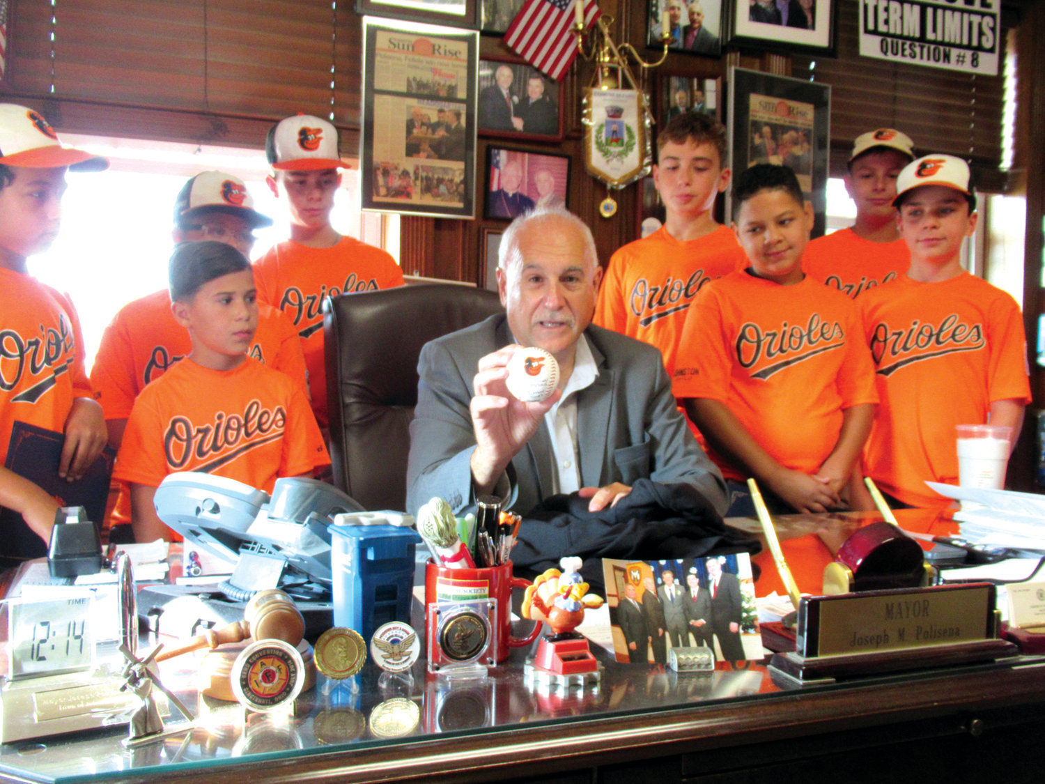 MIGHTY MOMENTO: Mayor Joseph Polisena holds the official game ball which was used during the 2019 Johnston Little League's Town Championship finale won by the Orioles for the fourth time in last nine seasons.