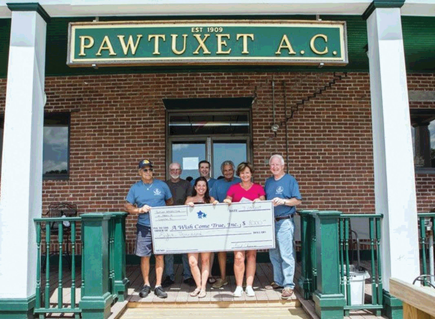 MAKING A DIFFERENCE: Pawtuxet Athletic Club Tournament Committee members and charity recipients gather during the June 2 fishing tournament finale event. Pictured are, back row from left, Skip Pettis, Jimmy Gosselin and Fred Chiarini; and front row from left, Bob Souza, Amy Conlan and Mary-Kate O'Leary from A Wish Come True and Bill Shaw.