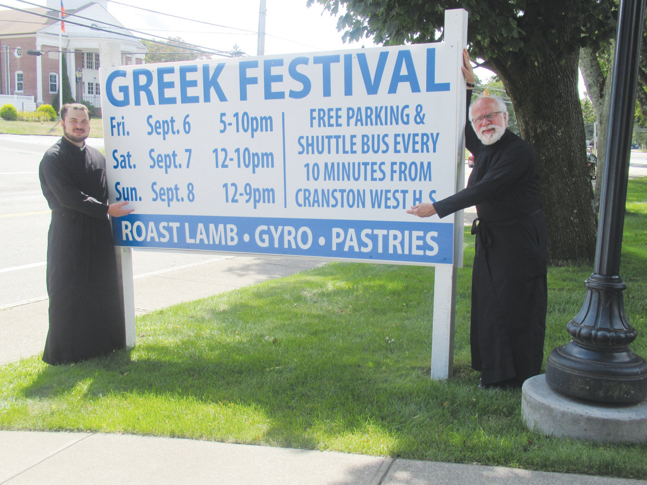 PARISH PERSENTORS: Church of the Annunciation Assistant Pastor Nicholas Lanzourakis, left, and Pastor Andrew George extend an invitation for Rhode Islanders to visit the 34th annual Cranston Greek Festival.