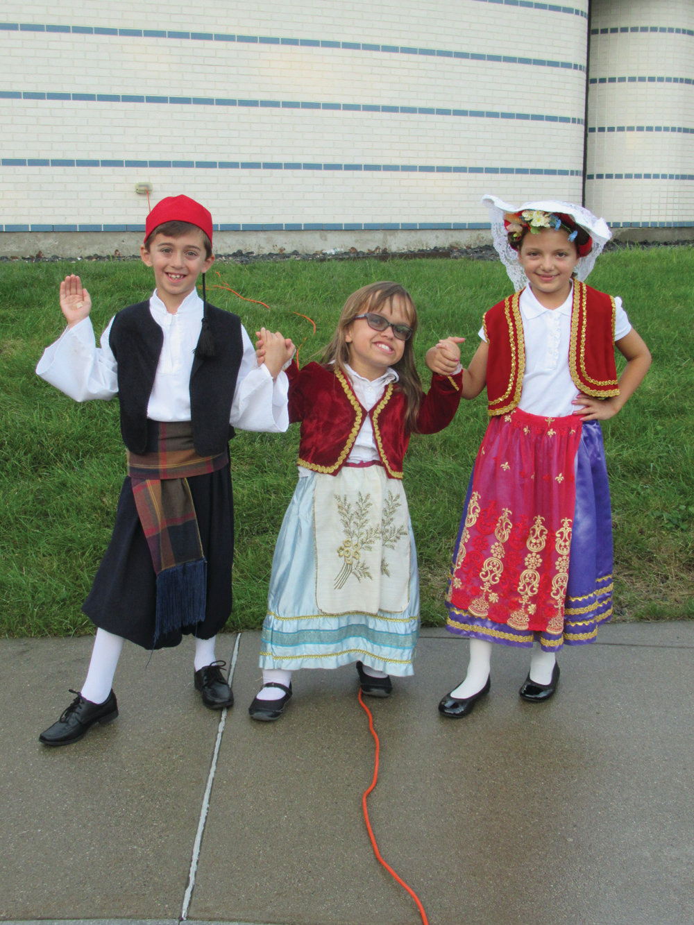 TALENTED TRIO: Among the younger members of the Church of the Annunciation's Odyssey Dance Troupe are, from left, Kosta Rougas, Sophia Nichols and Stella Andriotis. They will participate in five different performances during the three-day Cranston Greek Festival.