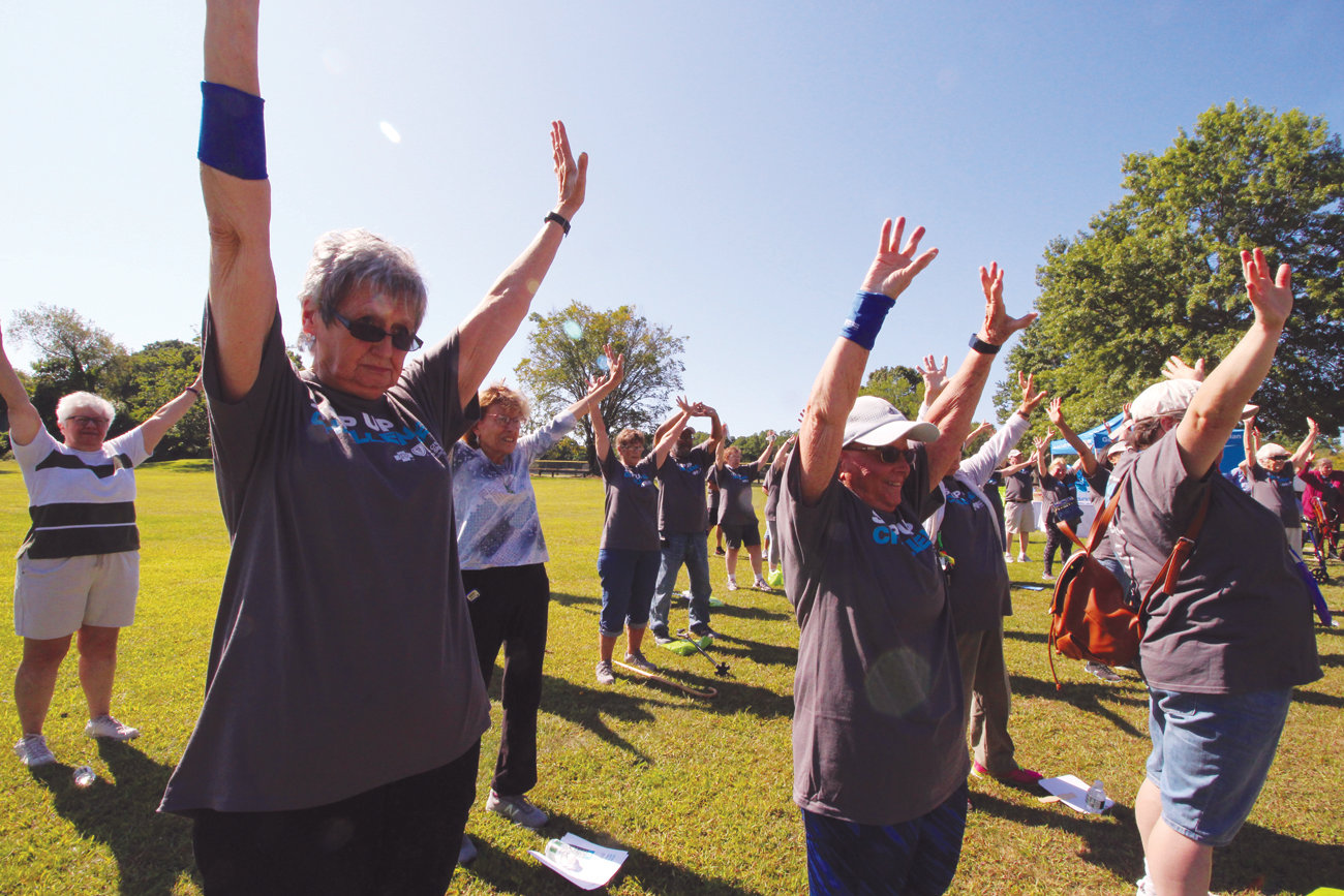 STRETCHING BEFORE STEPPING: Seniors from centers across the region limber up during the kickoff to the Step Up Challenge.