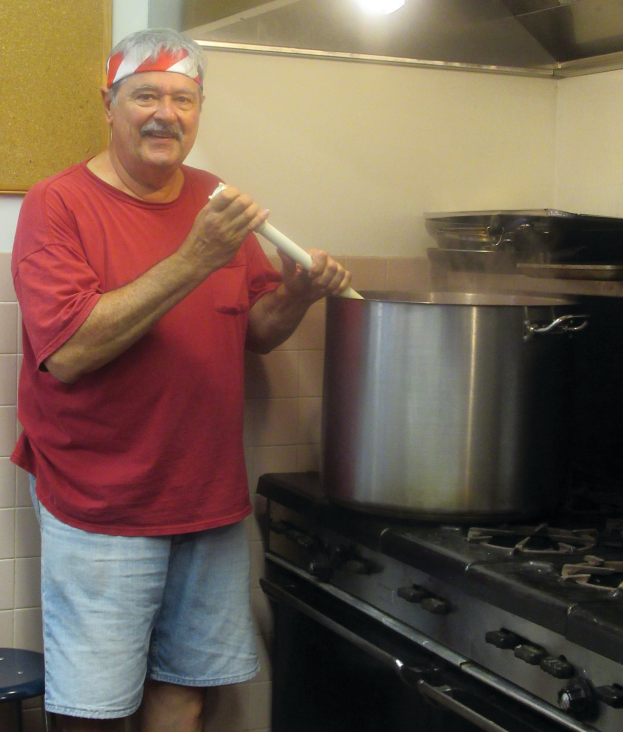 "SPECIAL SAUCE: ""The proof is in the gravy"" – so says Al Colannino as he stirs up a special batch of Italian sauce that will cover countless plates of macaroni and other Italian foods during this weekend's 91st Feast and Festival in Johnston."