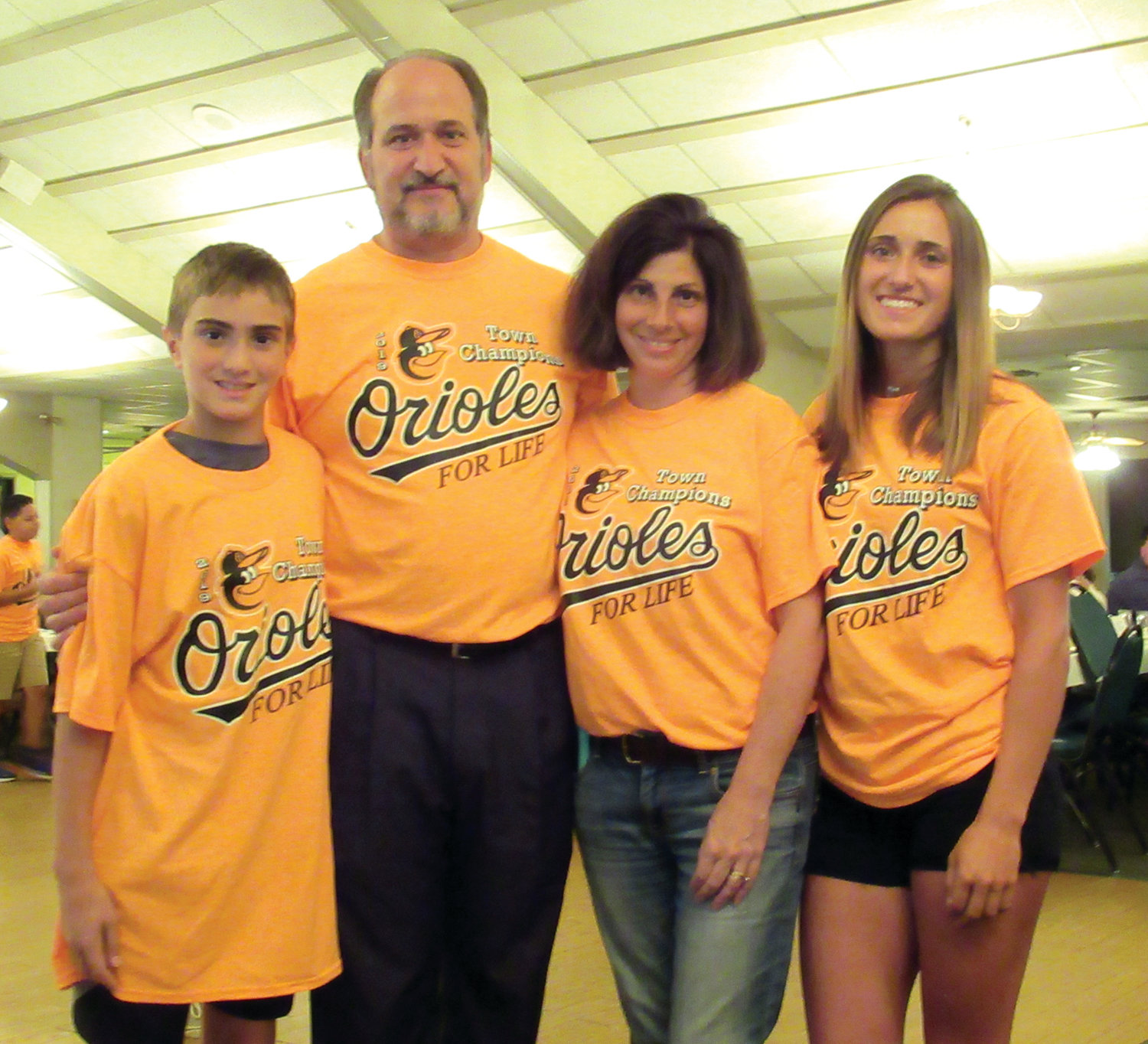 SPECIAL SENDOFF: Former Johnston High School sports standout Lauren Civetti (right) enjoyed a super special sendoff while helping her father's Lisi Construction-Johnston Lions Club-sponsored Town Champion Orioles bask in the spotlight at the JLL's annual awards banquet. Like the O's family, she sported an Orioles T-shirt and enjoyed the dinner at Wright's Farm in Burrillville. After the fun-filled event, Lauren and her parents, O's long-time coach and Councilman Robert Civetti and mother Carol loaded up their car and headed for Towson, Md. where Lauren began practicing for her sophomore season with the highly-regarded NCAA Division I Towson State University women's fast-pitch softball team. Chris Civetti (left) was also honored at the dinner as a member of the 2019 state champion Junior Division All-Stars.