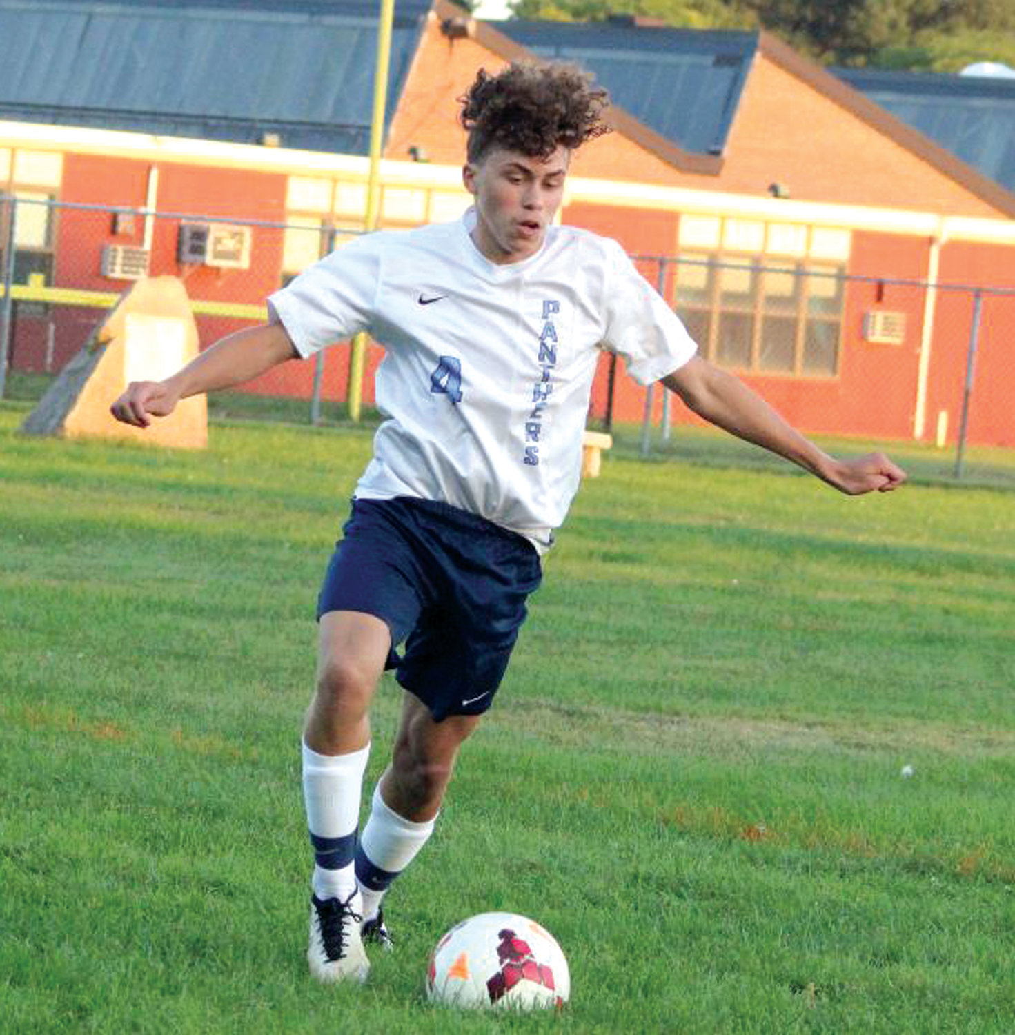 GETTING THE WIN: Johnston's Carlos Monterro dribbles the ball up the field against Toll Gate on Tuesday.