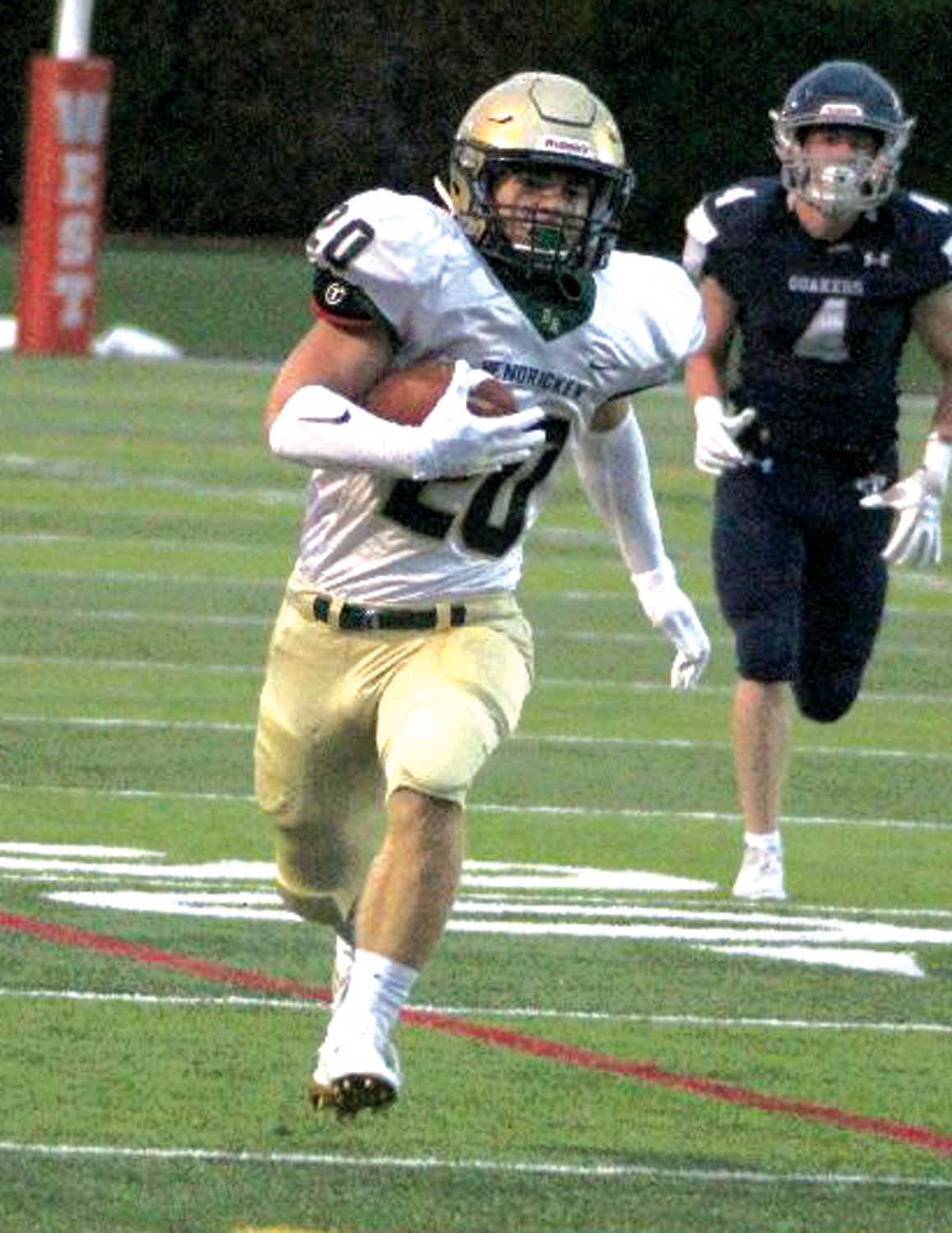 FOR THE SCORE: Bishop Hendricken's Nic Comella sprints his way to a touchdown last week.