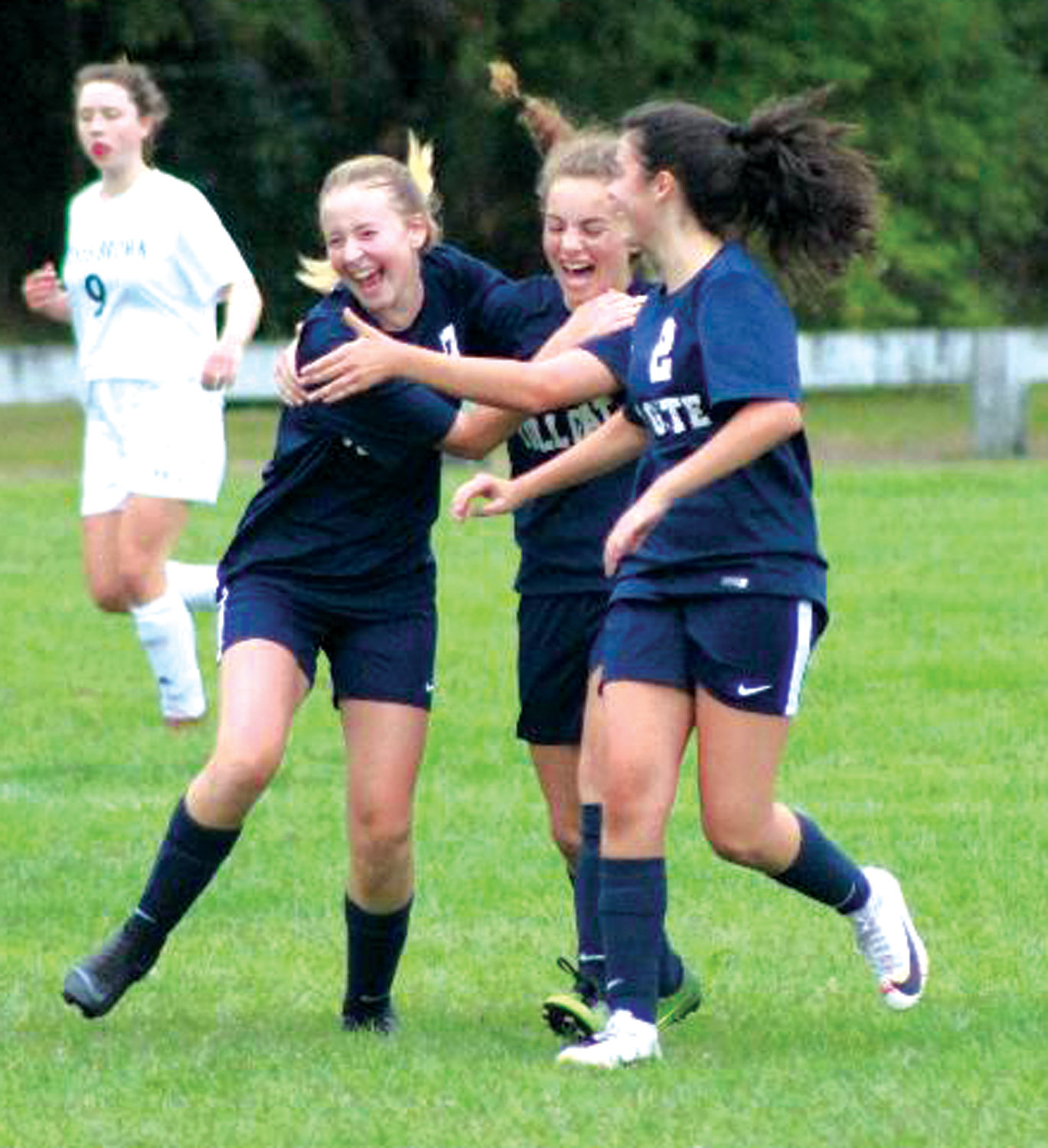 TEAMWORK: Members of the Toll Gate girls soccer team celebrate after scoring against Moses Brown.