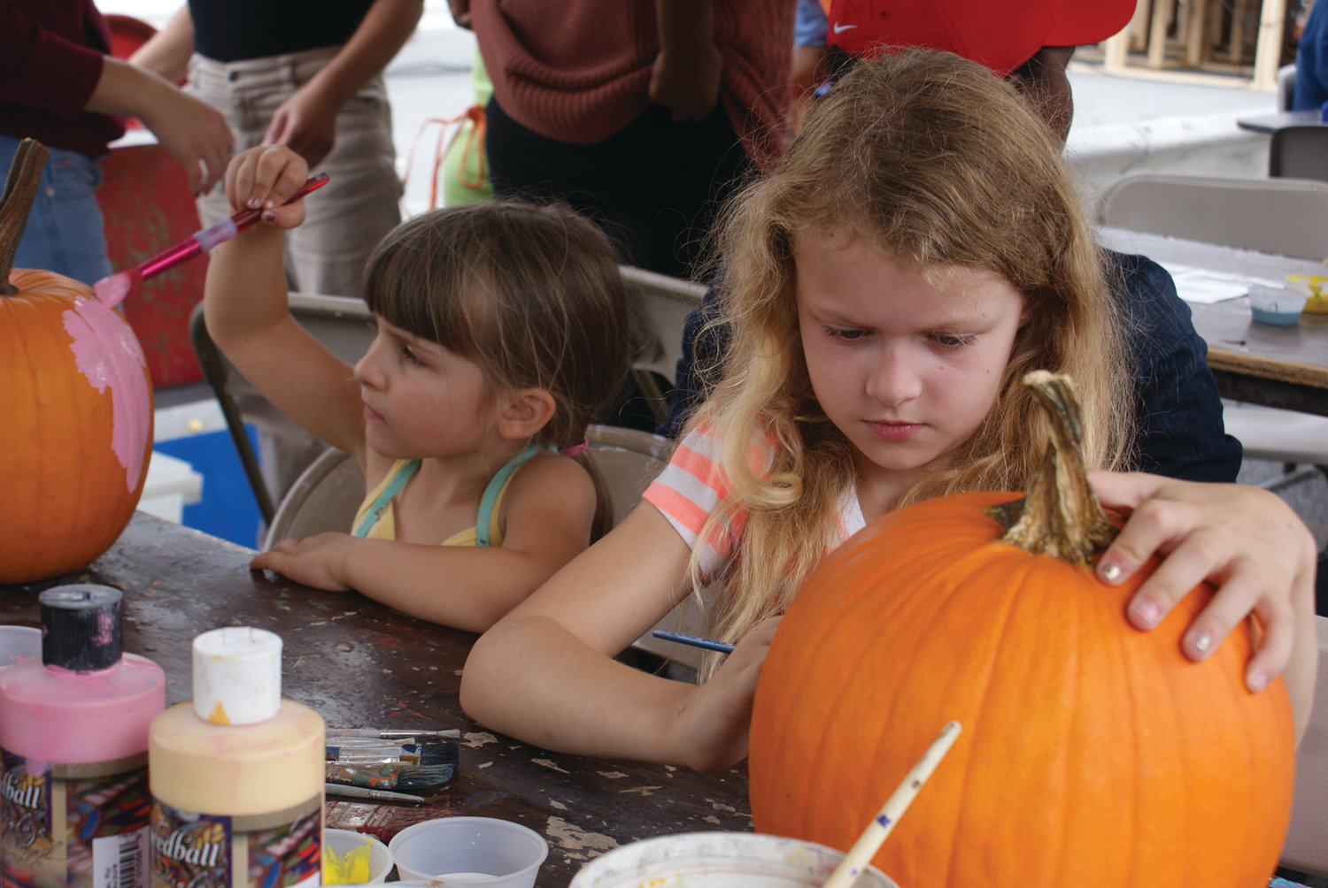 GREAT PUMPKINS: Children work on their entries for the pumpkin decorating contest during the Fall Out of Summer Arts Festival on Rolfe Square in this 2016 file photo. The contest will return during this year's festival on Sept. 22.
