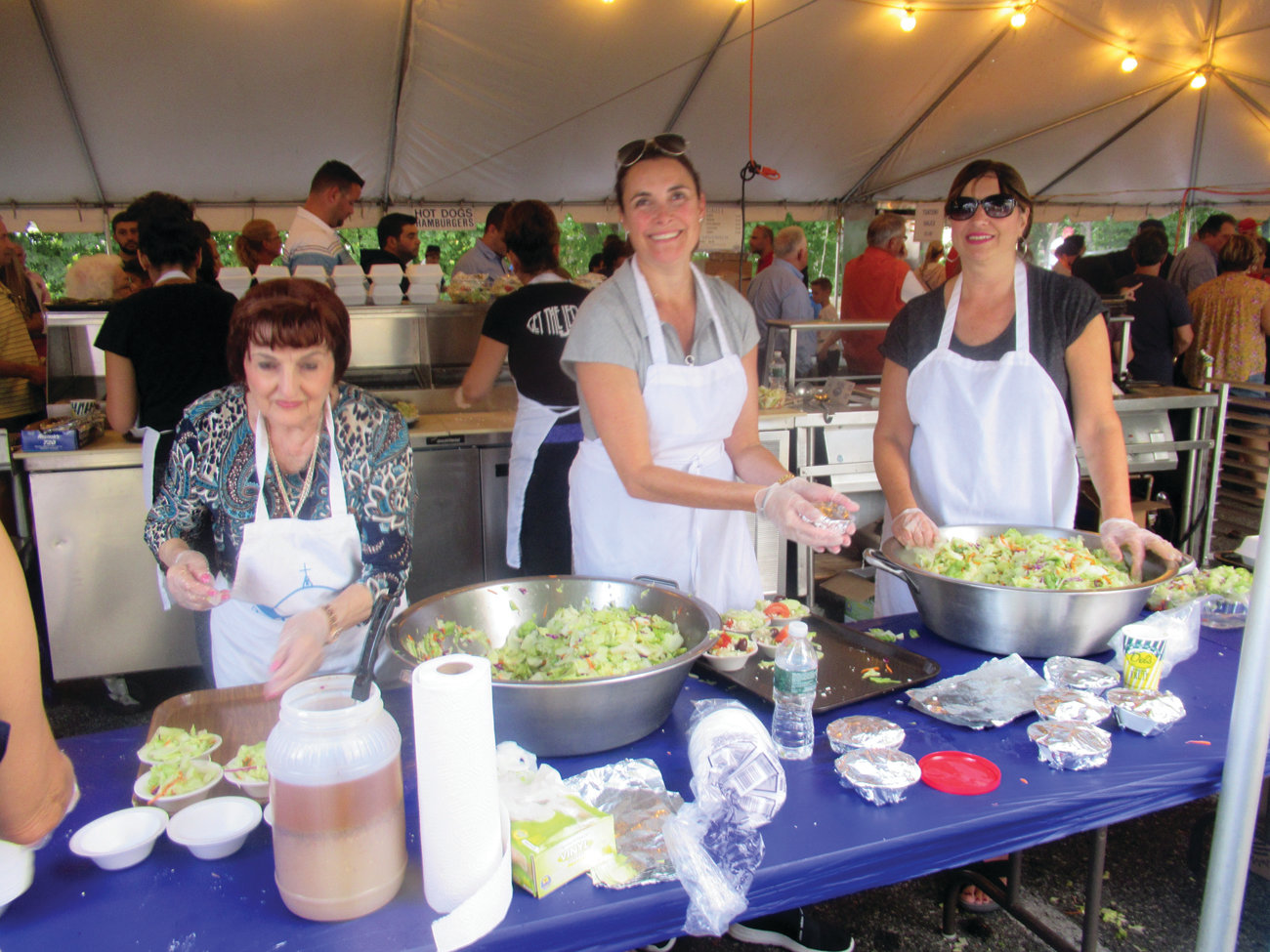 SPECIAL SALADS: Ladies like Angela Provost, Paula Demetrakas and Maria Menard mix another batch of Greek salads for attendees at the Cranston Greek Festival.