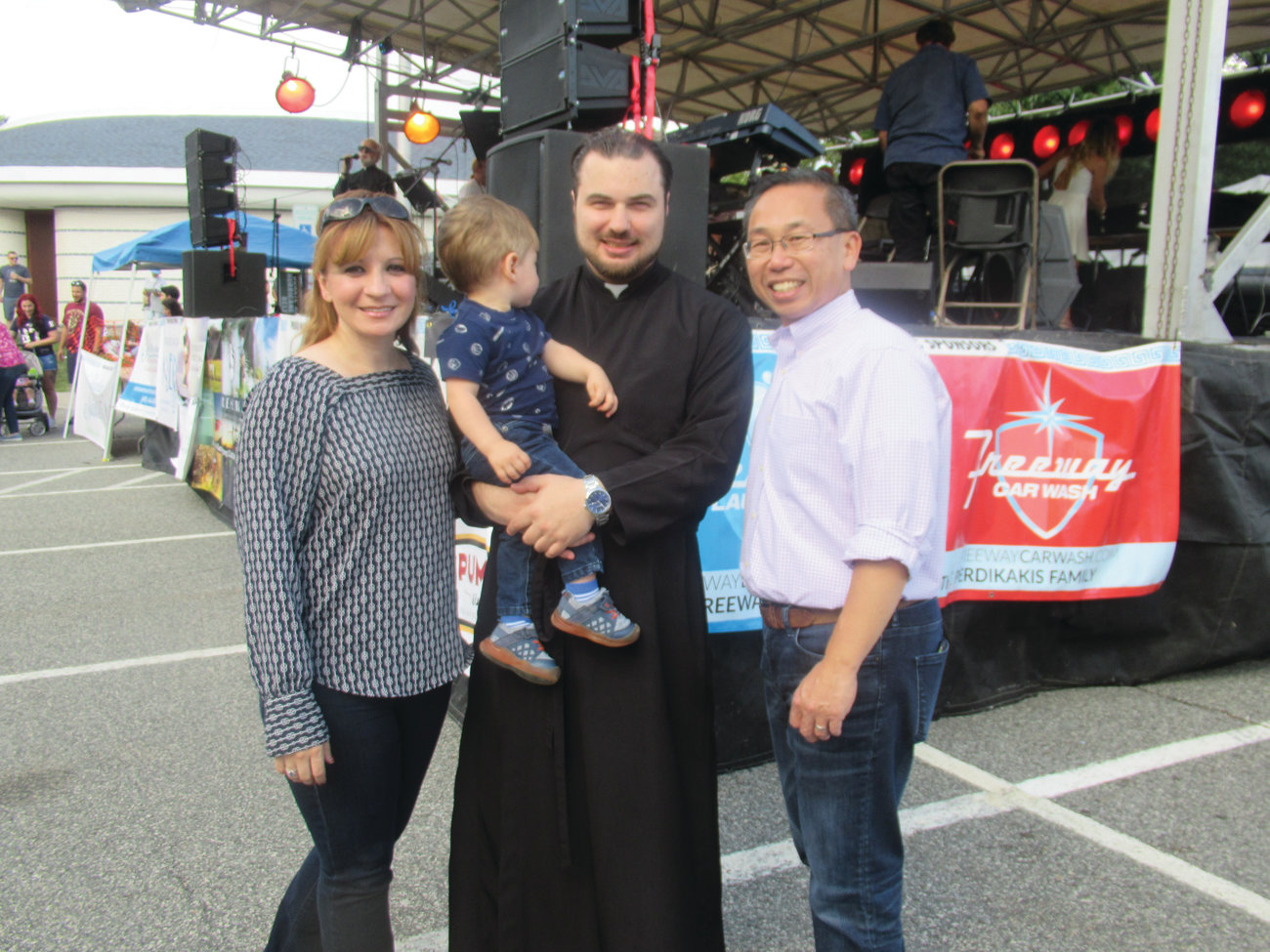 GRAND GUESTS: Father Nicholas Lanzourakis, the new assistant pastor at the Church of the Annunciation, and his son Polydoros greet Barbara Ann Fenton and Mayor Allan Fung during the festival.