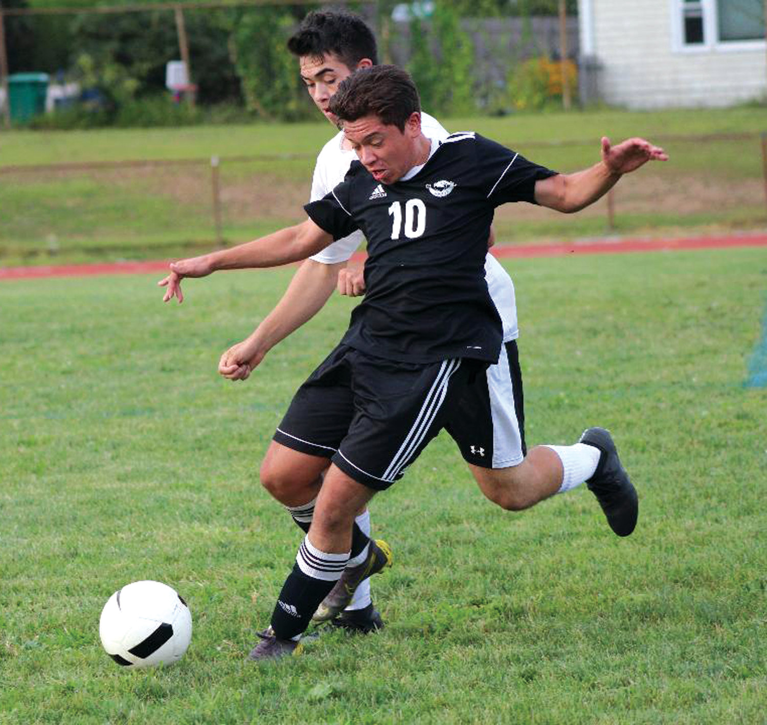 UP THE FIELD: Pilgrim's Josh Delaroca battles for possession.