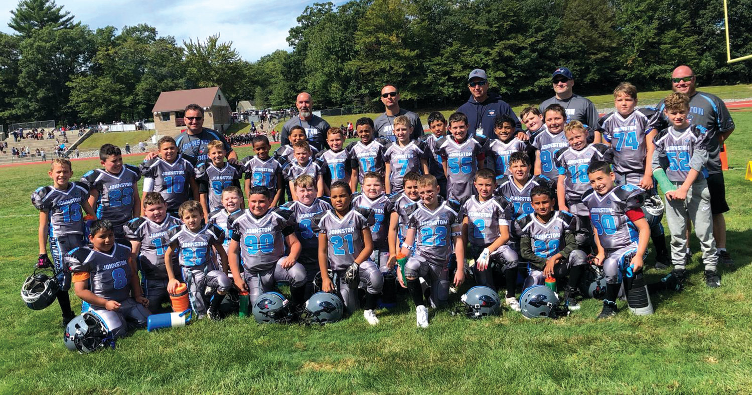UNDEFEATED: The Johnston Youth Football 9-U squad.