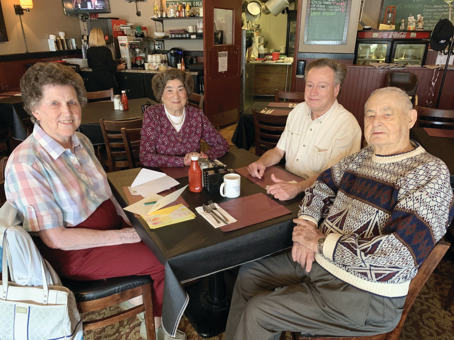 Friends and daily regulars at Buttonwoods 416 on Buttonwoods Avenue in Warwick gather for their daily meal.  Meet (from left to right) Marilyn Colvin, Irma Carolan, Mark Brown and Bob Deady!  Make note that Buttonwoods 416 is now closed on Mondays and Tuesdays!