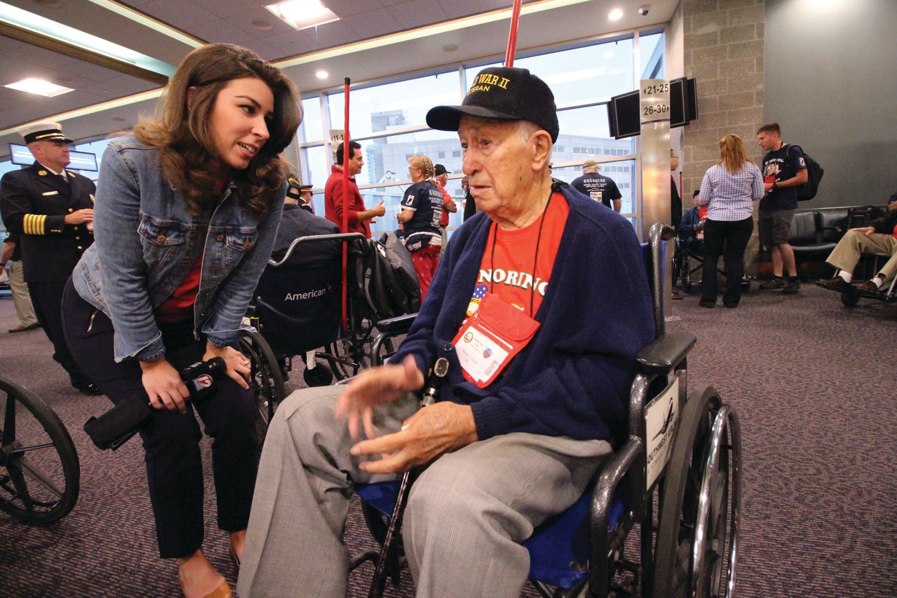 THERE FOR THE INTERVIEW: After seeing a segment of Caught in Providence where WWII veteran Victor Colella  contested a speeding ticket, WPRI reporter Kim Kalunian was sure to interview the Johnston resident before he left on Saturday's Honor Flight.