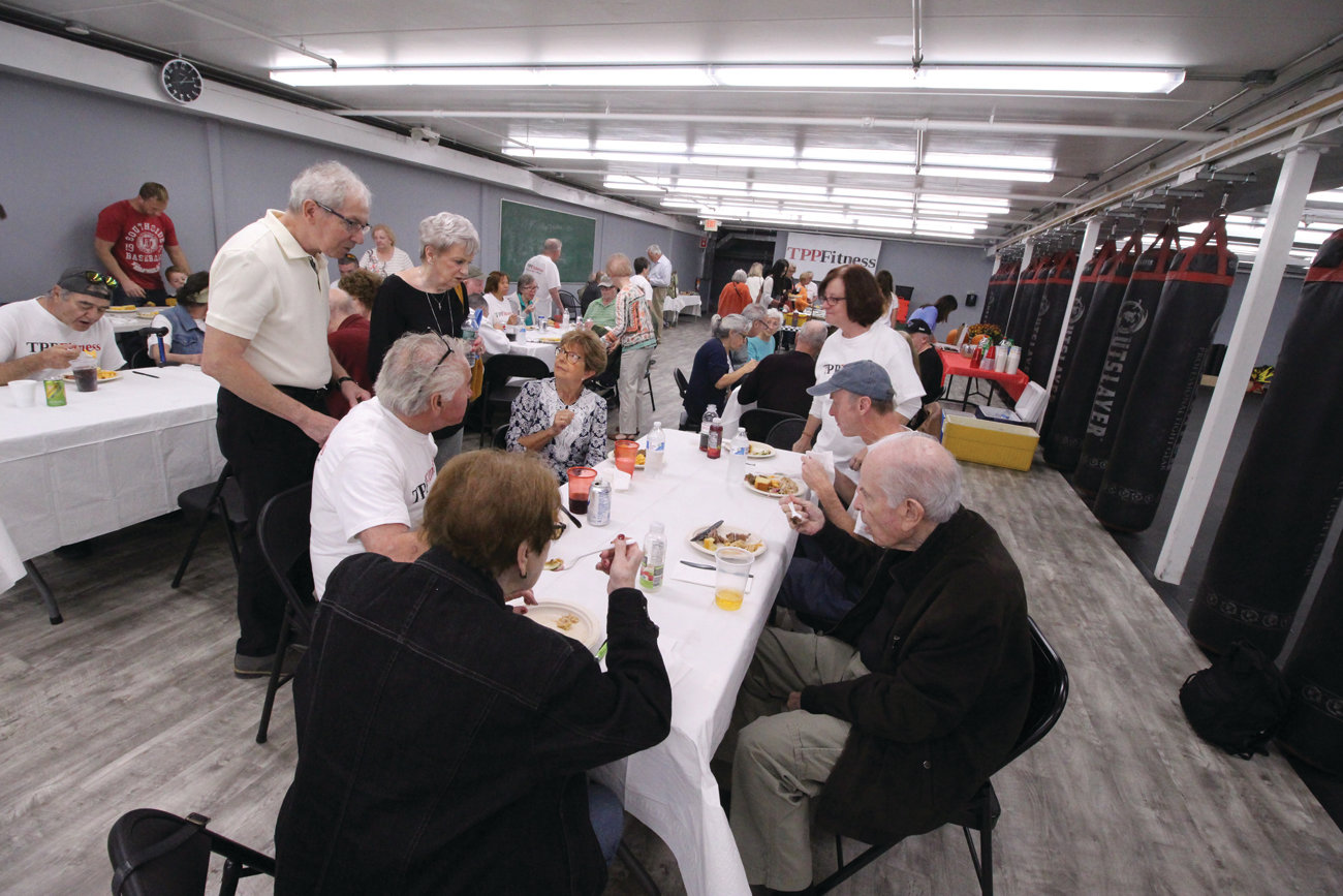 FOOD FOR WELLNESS: Lunch was served in a section of the gym familiar to many of those in attendance, as that is where they participate in Rock Steady sessions aimed at helping those with Parkinson's gain control, balance and strength.