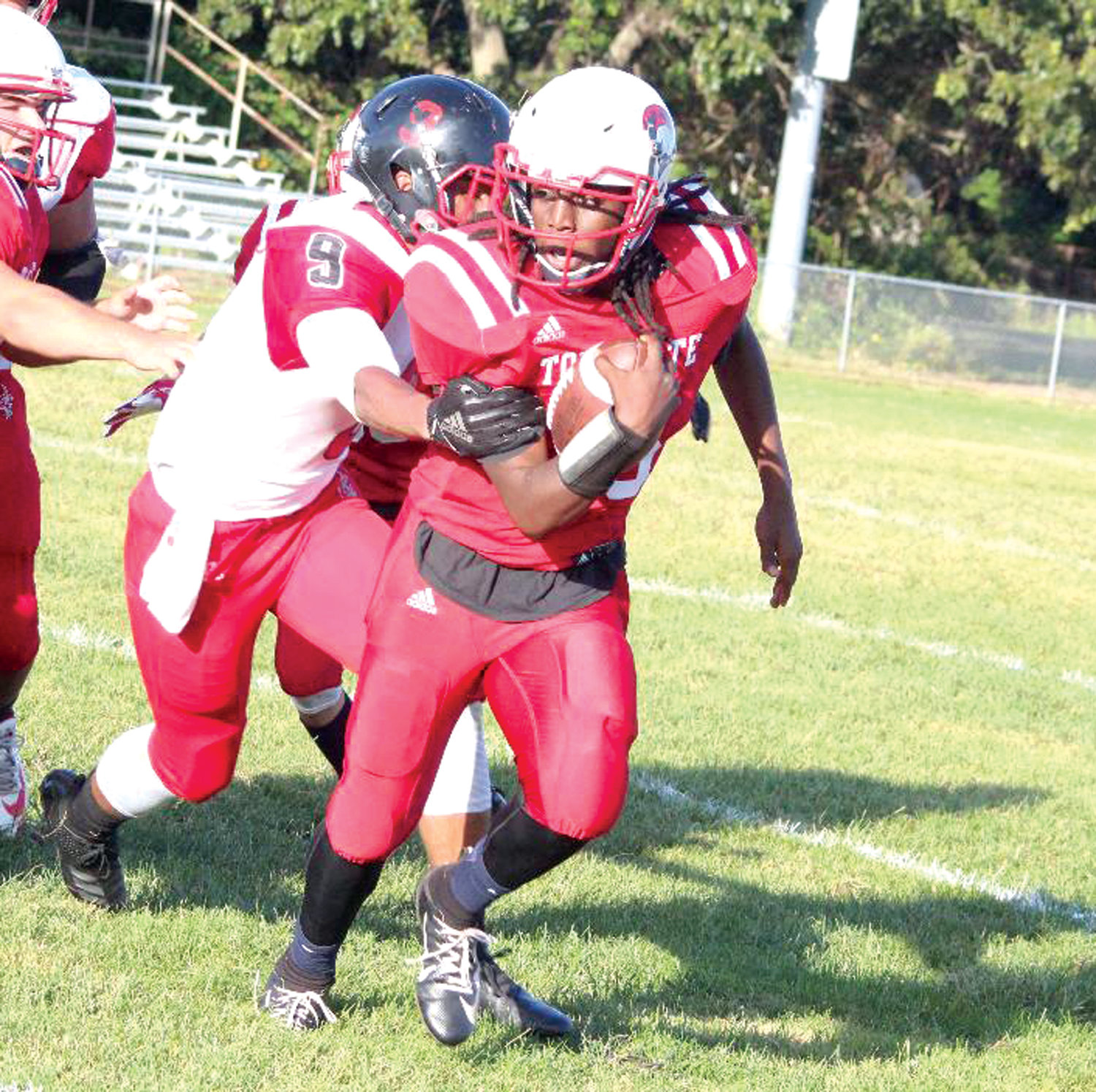 UP THE MIDDLE: Toll Gate running back Ethan Durand picks up some yards.
