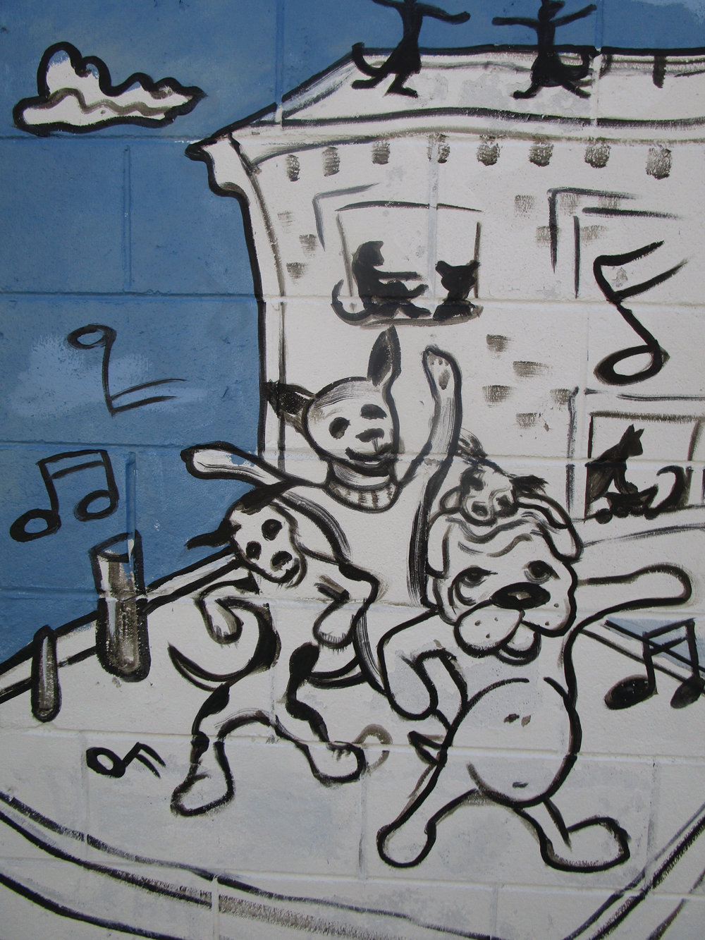 MOVING AND SHAKING: Cartoon dogs groove to the music in this scene from Rob Ratigan's mural.