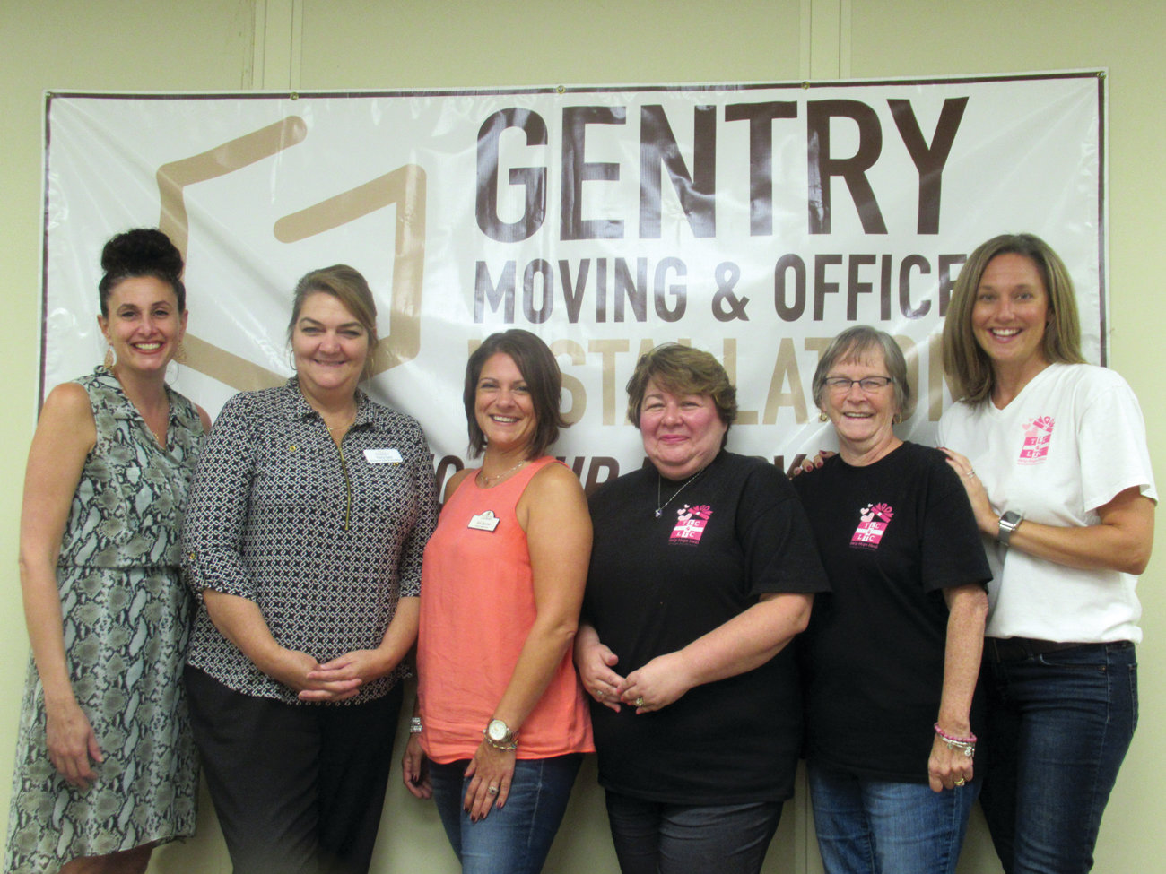 SPECIAL SUPPORTERS: Christine Crum, left, who owns and operates Gentry Moving & Storage in Cranston, co-chaired the Cornhole Elimination Tournament and hosted the fundraiser when the event was threatened by rain. She's joined by committee members Tracy Cale, Jen Burns, Lisa Ferreira and Karen Morin. Not pictured are Kelly Marot and Pam Marchetti.