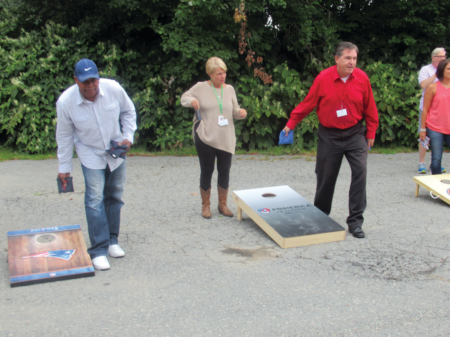PROLIFIC PLAYERS: This was the scene earlier this month at Cranston-based Gentry Moving & Storage as a Cornhole Elimination Tournament raised $1,400 for the nonprofit TLC4LTC.