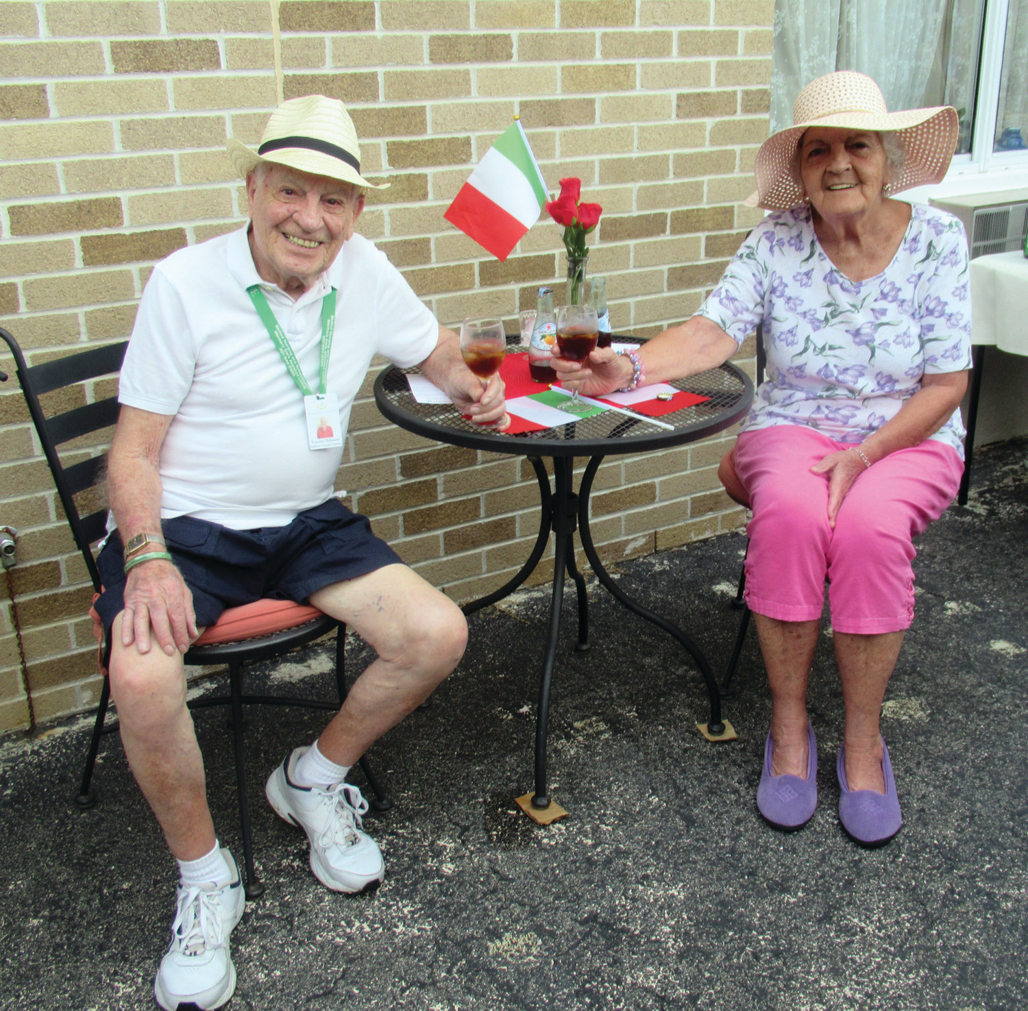 SALUTE! Briarcliffe Manor residents Vinny DiDonato and Doris Boucher offer a toast during Tuesday's Taste of Italy.