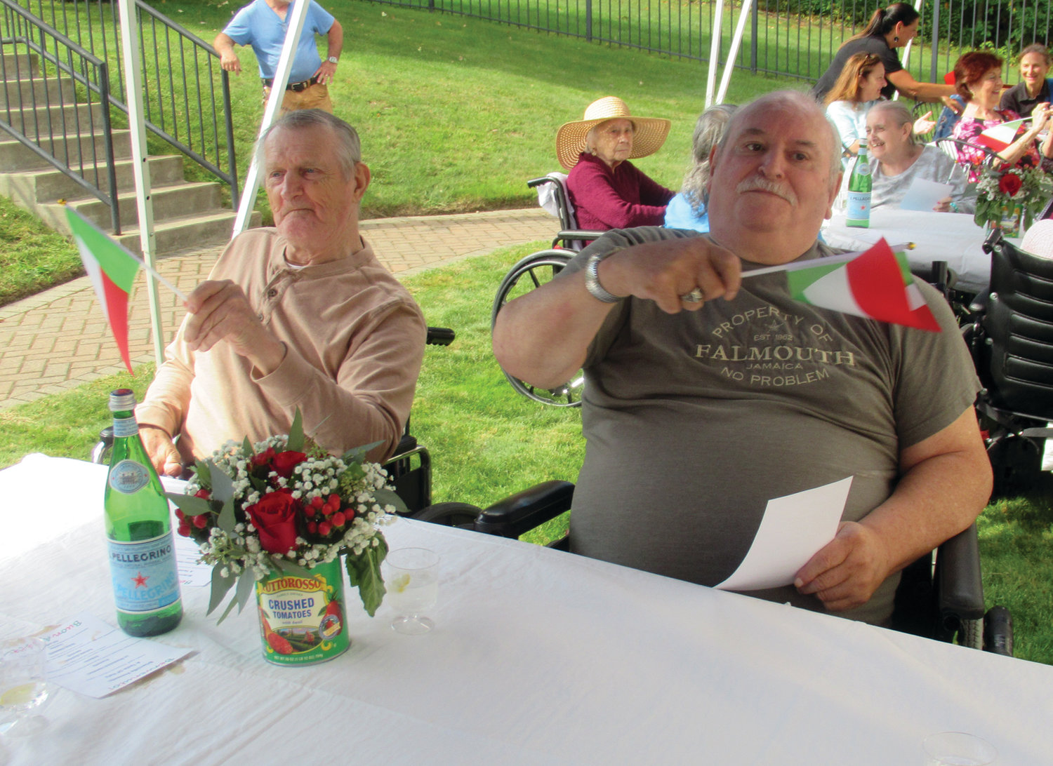 FLAG FUN: These Briarcliffe Manor residents raised – and waved – small Italian flags that were all part of Tuesday's fun and food-filled Taste of Italy.