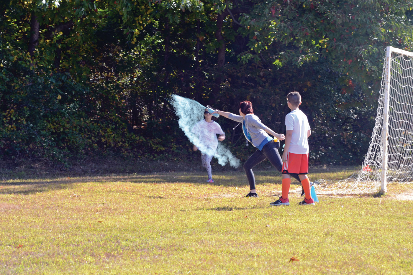 LIKE MAGIC: A Hoxsie student prepares to run through a cloud of the colorful dust.