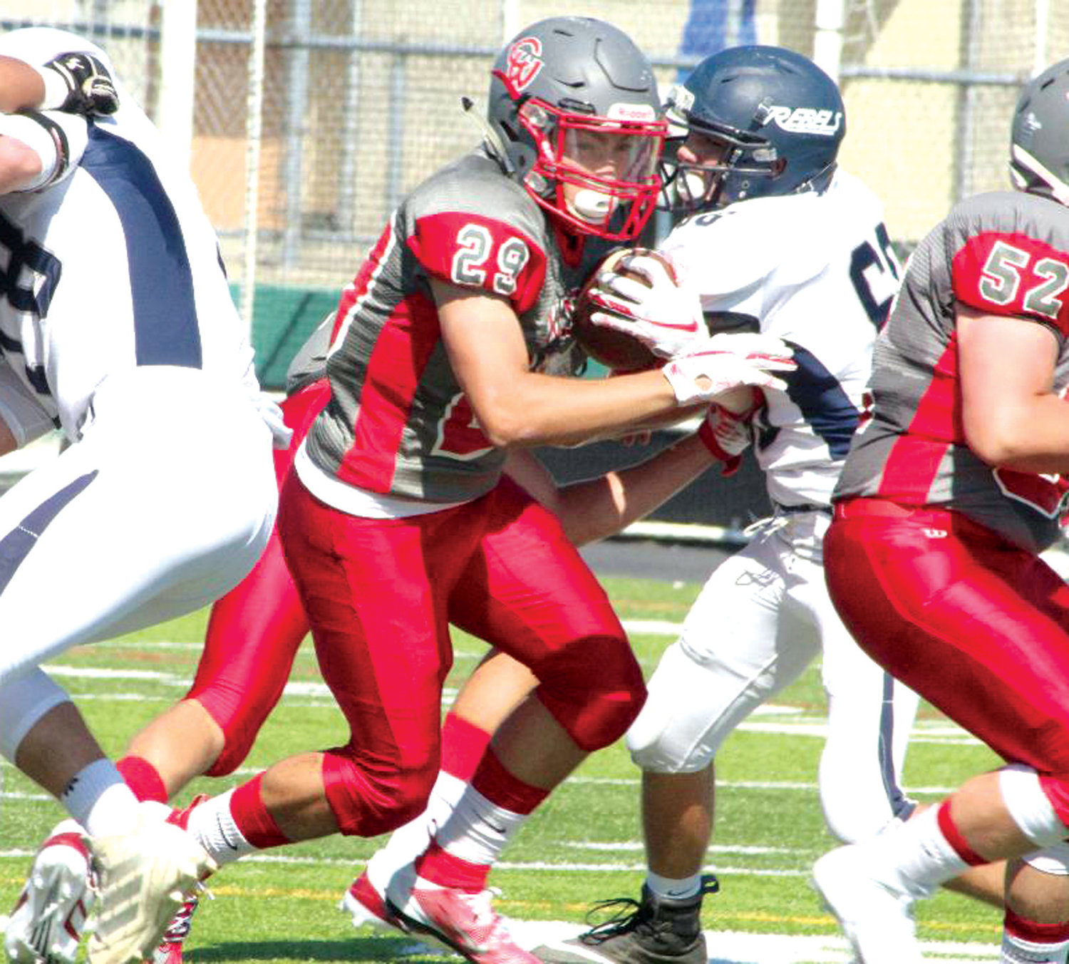 UP THE GUT: West's Brennan Stetson picks up some yards.