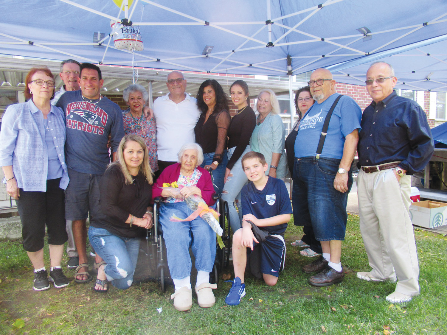 NANA'S NICHE: Margaret Pinelli DiMuccio (center), who was born on Sept. 30, 1914 in Providence, is surrounded by her family during Sunday's 105th birthday bash at the West Shore Health Center in Warwick. The group includes: Judy Crudale, Andrew Crudale, Trina DiMuccio, James Crudale, Sandra Frazee, Michael DiMuccio, Gina Sabitoni-Arakelian, Giavanna Arakelian, Donna Martinez, Linda DiMuccio, John DiMuccio, Deloy Martinez and Norman Fazee.