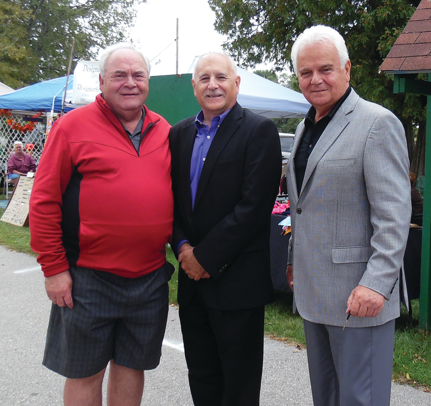 A MELANCHOLY OCCASION: Northern Rhode Island Chamber of Commerce President John Gregory (left), seen here with Mayor Joseph Polisena and Police Chief Richard Tamburini, retired after 27 years in his post last Friday. Gregory said it was a melancholy day as he reflected on his time at the Chamber.