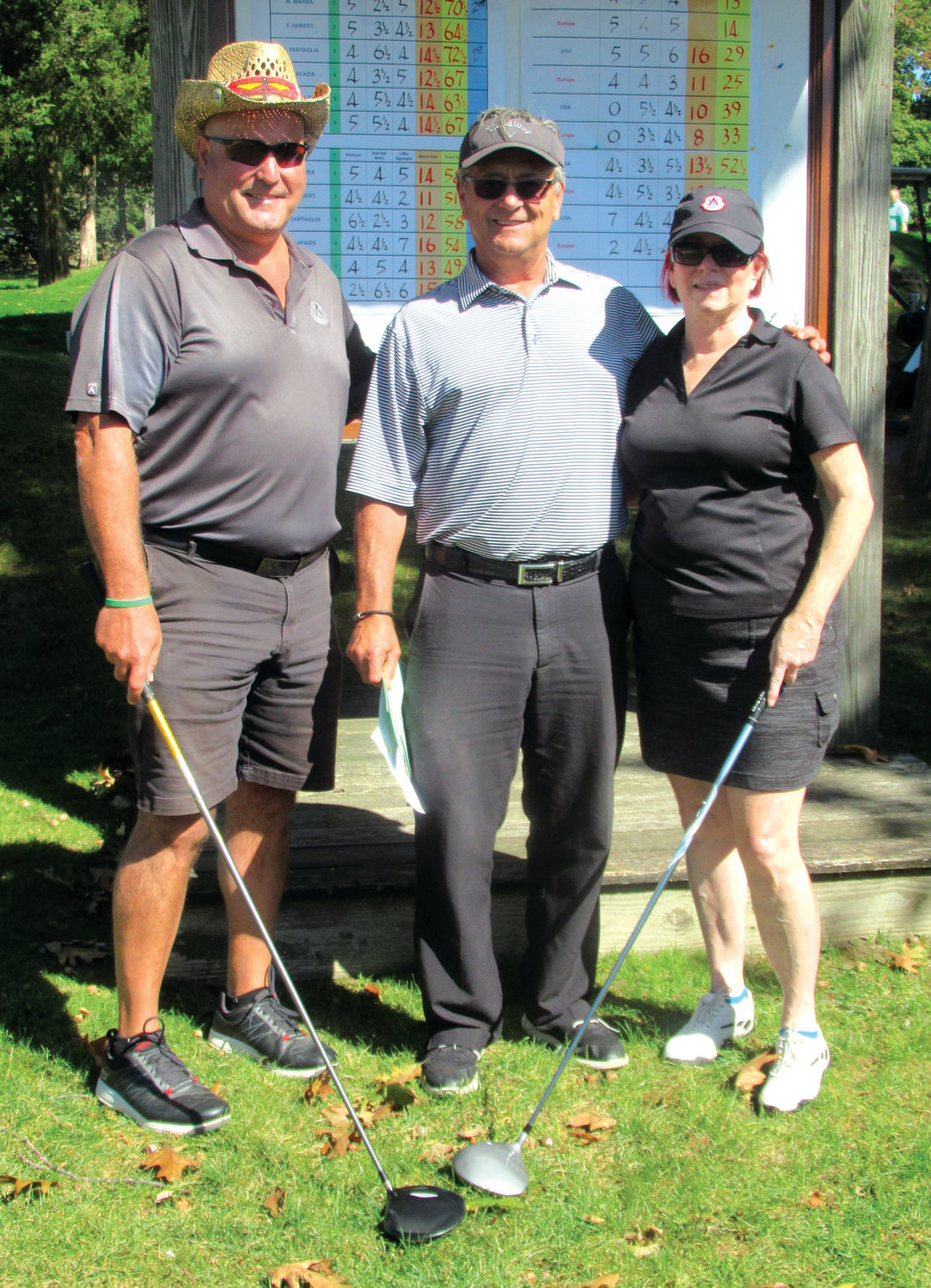 PRO'S PALS: GCC's popular pro Dave Baluik is joined by John and Patti Martin before they teed it up in the 5th Annual JMCE Memorial Golf Tournament.