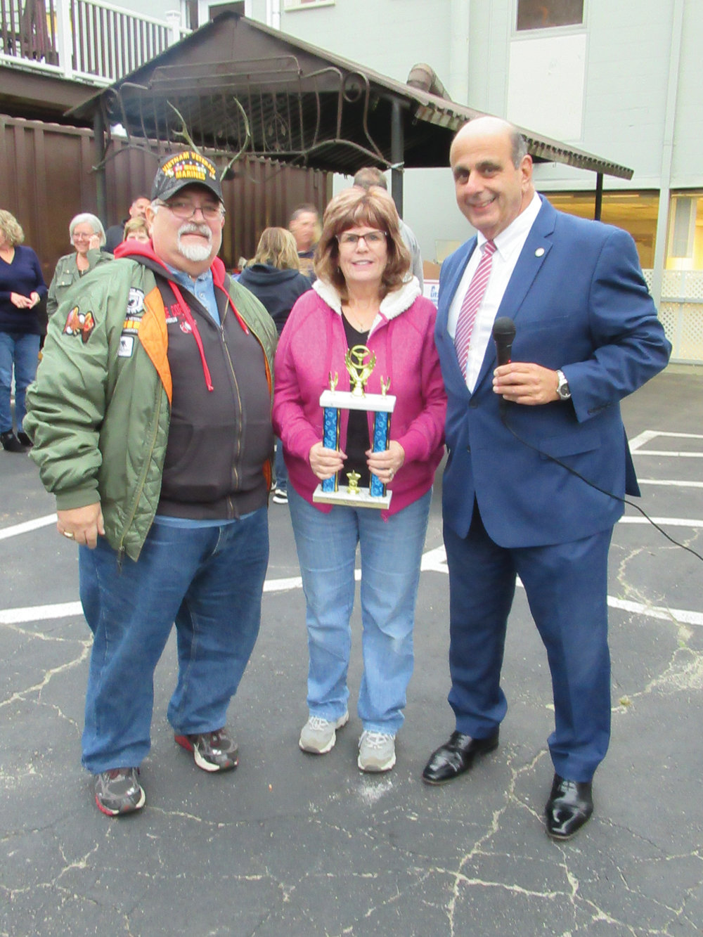 CAHOON'S CORNER: Ray and Barbara Cahoon are all smiles while receiving the initial Mayor's Pick Trophy during Thursday's final Elks Car Show of the 2019 season.