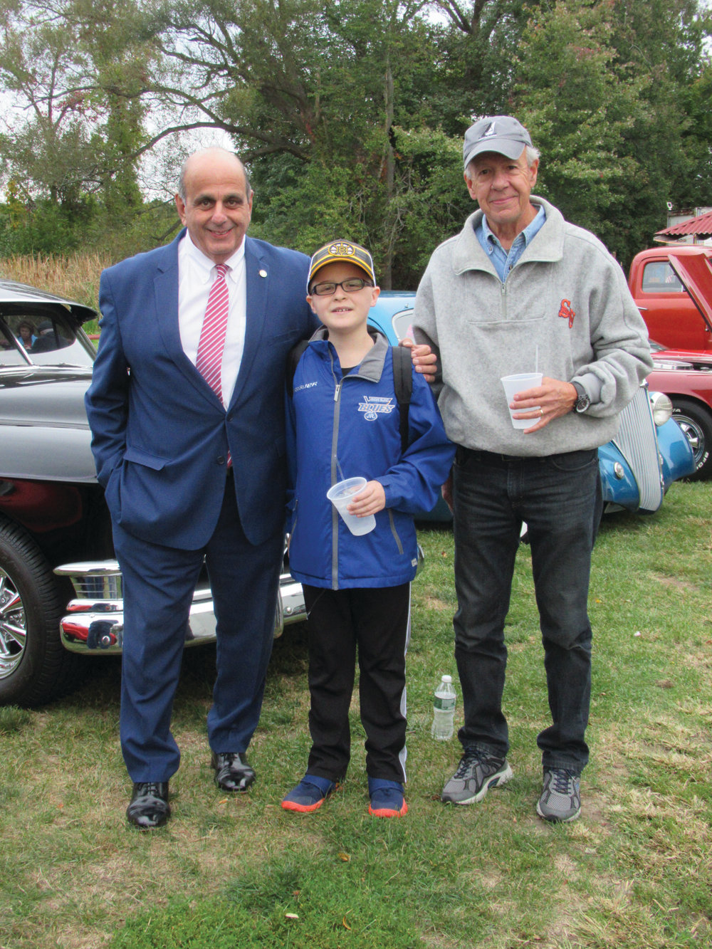 "MAYOR'S MEN: Mayor Joseph Solomon welcomes Cole Robinson – who he called ""My Hero"" – and his grandfather Al Robinson to the Elks' season-ending car show last Thursday night."