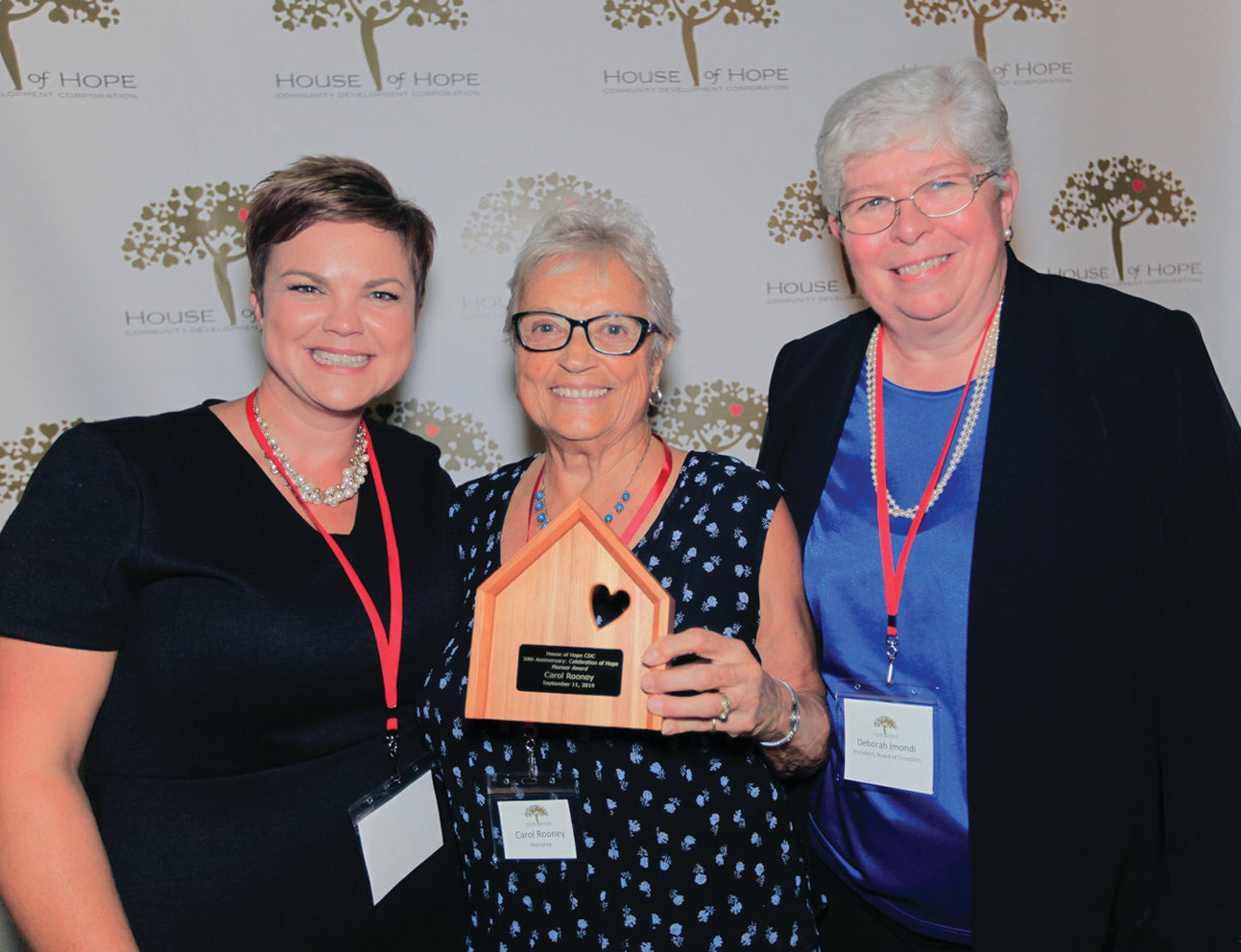 PROVIDENCE, RI -- Wed., April 27, 2016.BROWN LAX --  Brown University men's lacYEARS OF SERVICE: Carol Rooney (center) is presented the House of Hope Pioneer Award for her long-time efforts on behalf of the organization. She is flanked by Laura Jaworski, House of Hope Executive Director (at left), and Deb Imondi, House of Hope board of directors president.