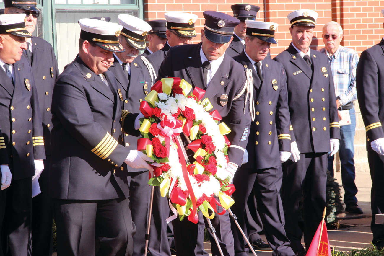 OFFICIALS LINE UP: Elected officials attending Sunday's Firefighters' Memorial Service gather for a group photograph before commencement of the ceremony.