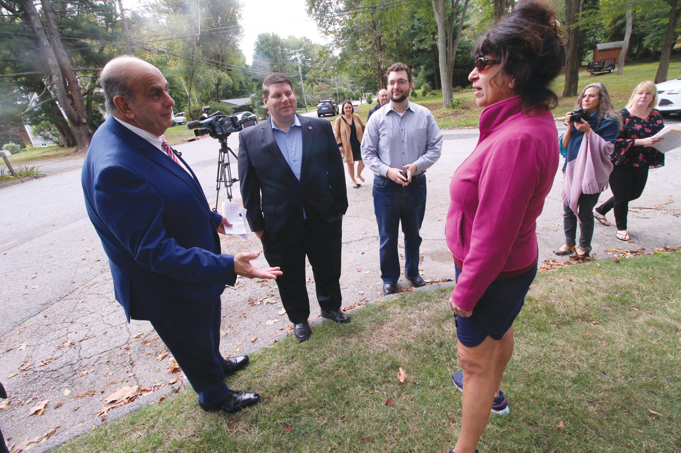 FIRST TO GET THE NEWS: Even before Mayor Joseph Solomon officially announced the program, Virginia Sardelli, who happened to come along the gathering on Gauvin Drive Thursday morning, learned of the mayor's plan to borrow more than $13 million to repave city streets.