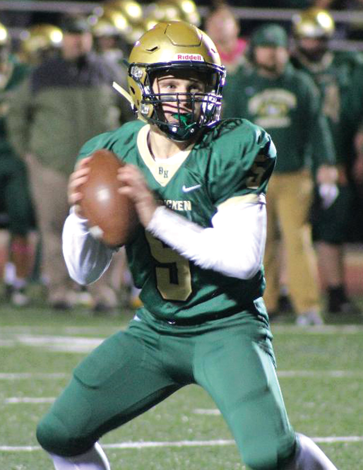 SIGNAL CALLER: Bishop Hendricken quarterback Tom Comella drops back to pass against rival La Salle last week during the team's 28-14 victory. Comella rushed and threw for touchdowns in the win.