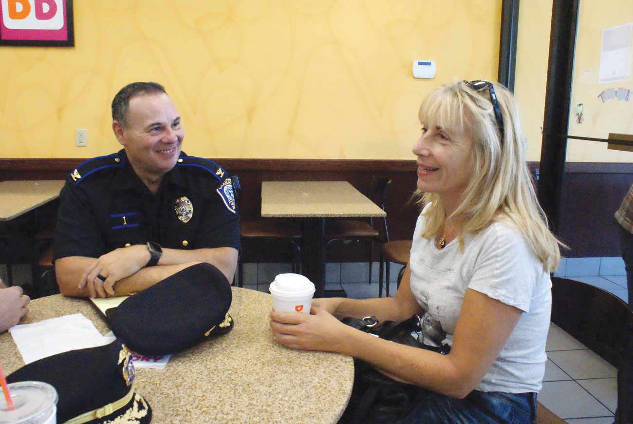 DISCUSSING DOGS: Suzanne Arena sat down with Chief of Police Col. Michael Winquist during the Coffee with a Cop gathering to discuss a recent incident involving a dog bite in her neighborhood.