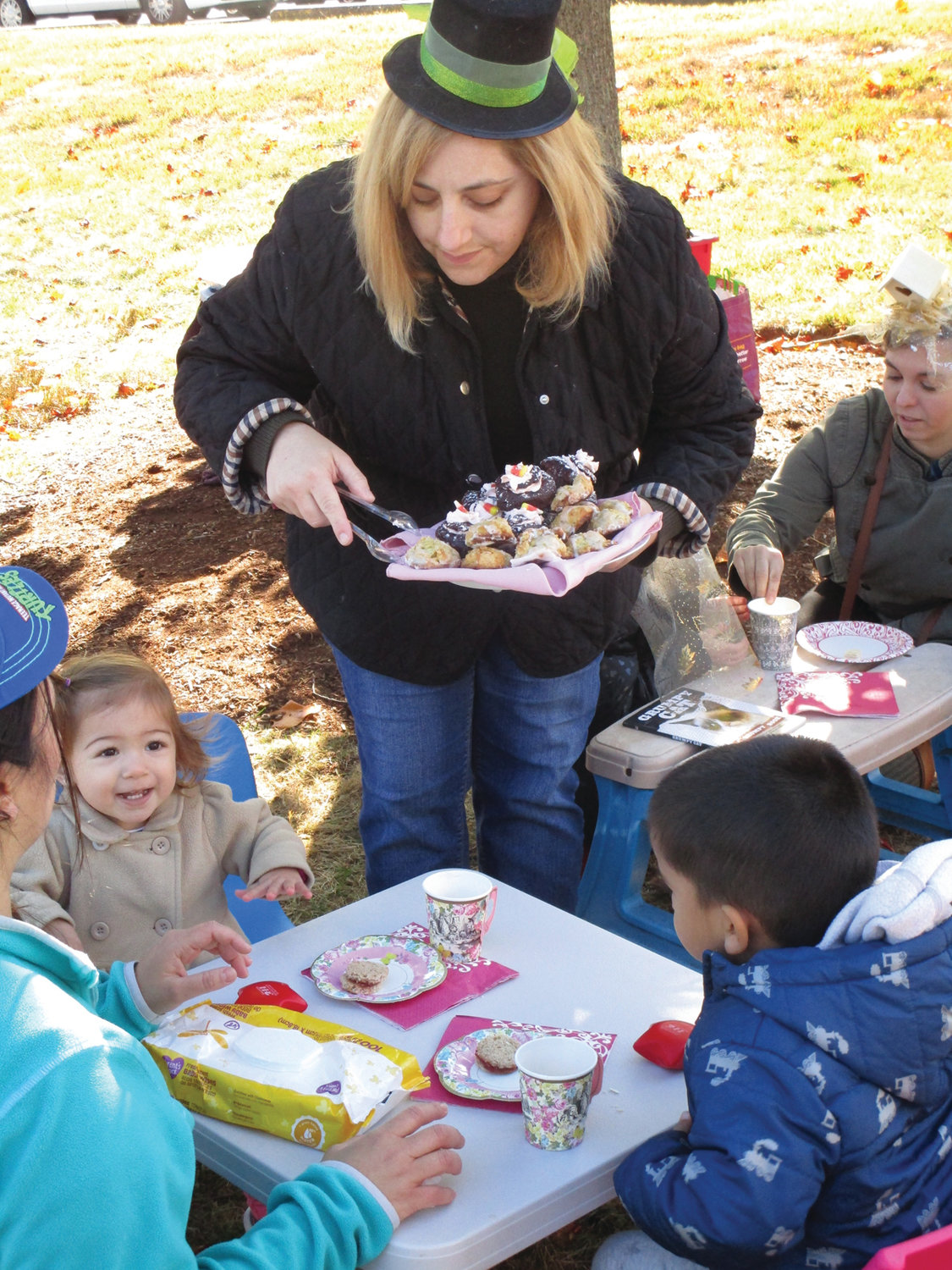 SPECIAL SERVING: Theresa McFarlane of Little Learners Playgroup serves up cupcakes to Abdiel Urizar and Elianny Matareno during the tea party.
