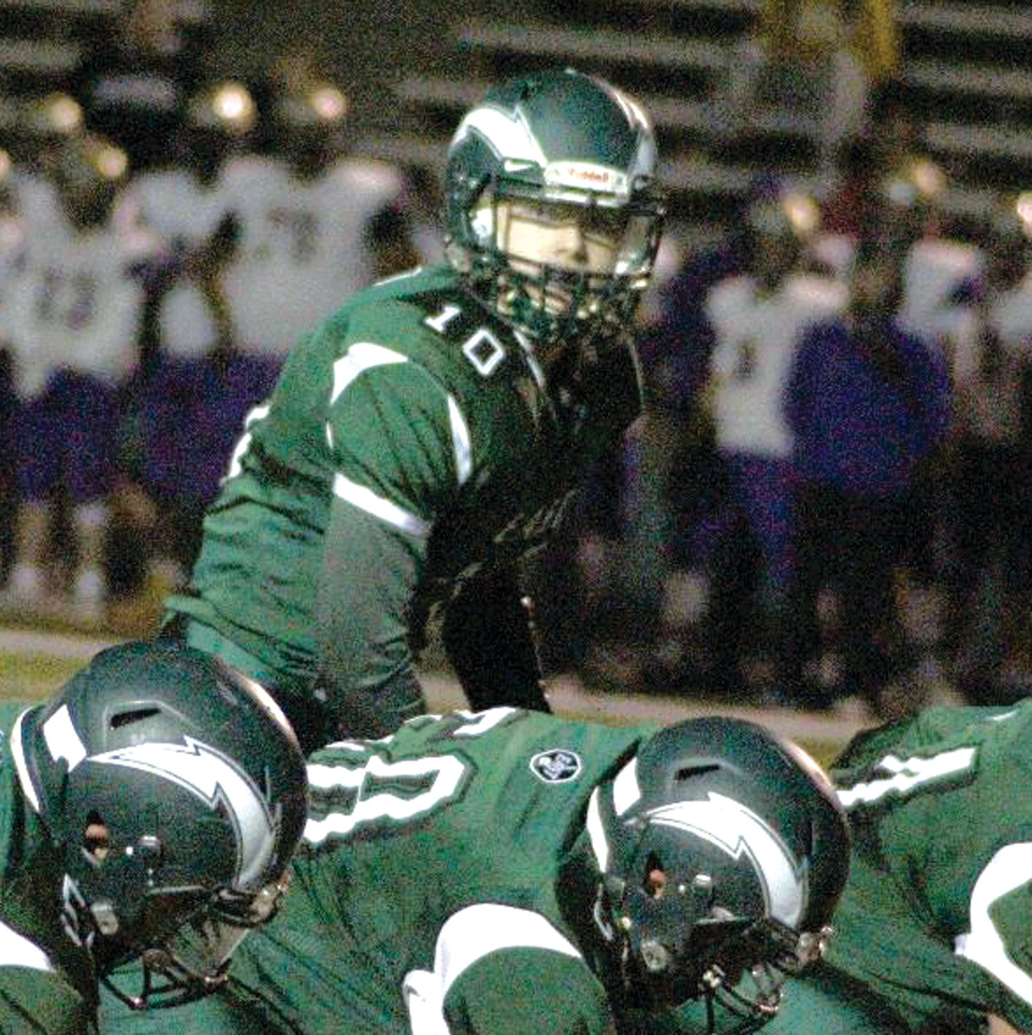 UNDER CENTER: Cranston East quarterback Ben Harding reads the St. Ray's defense last week.