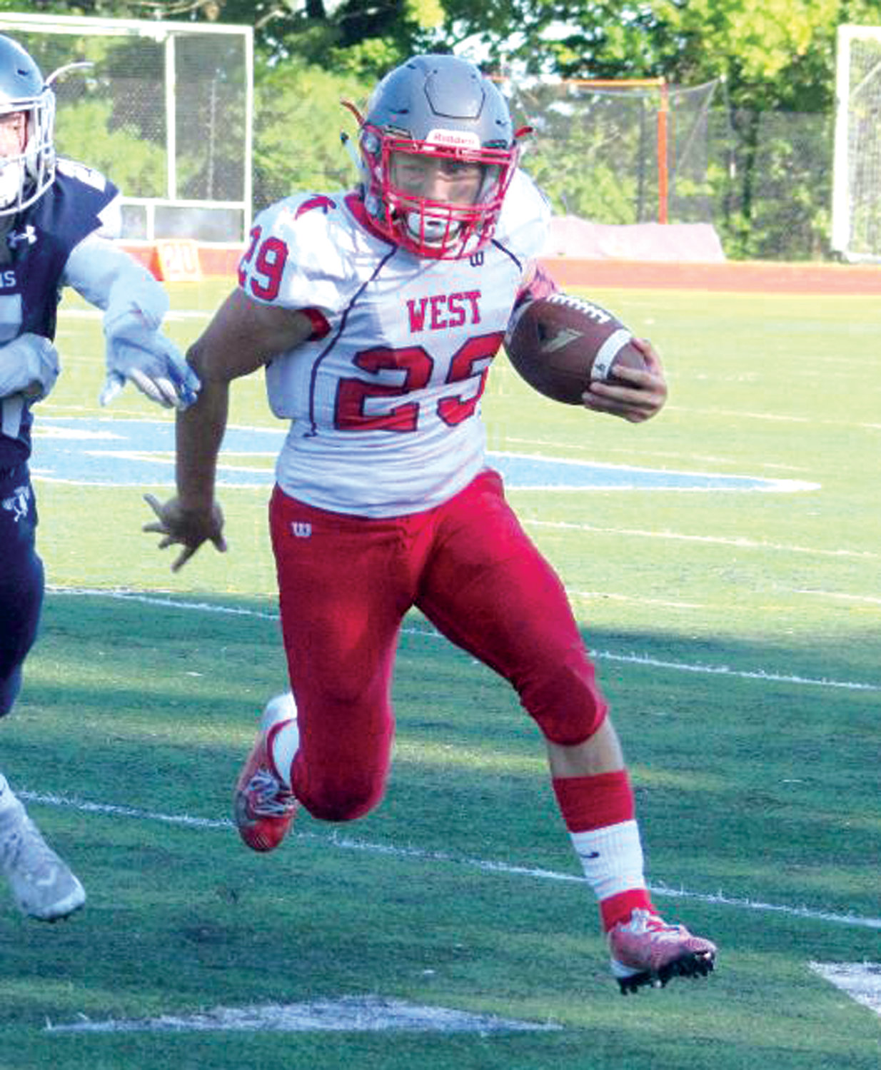 MOVING THE CHAINS: Cranston West's Brennan Stetson picks up some yards against Moses Brown.