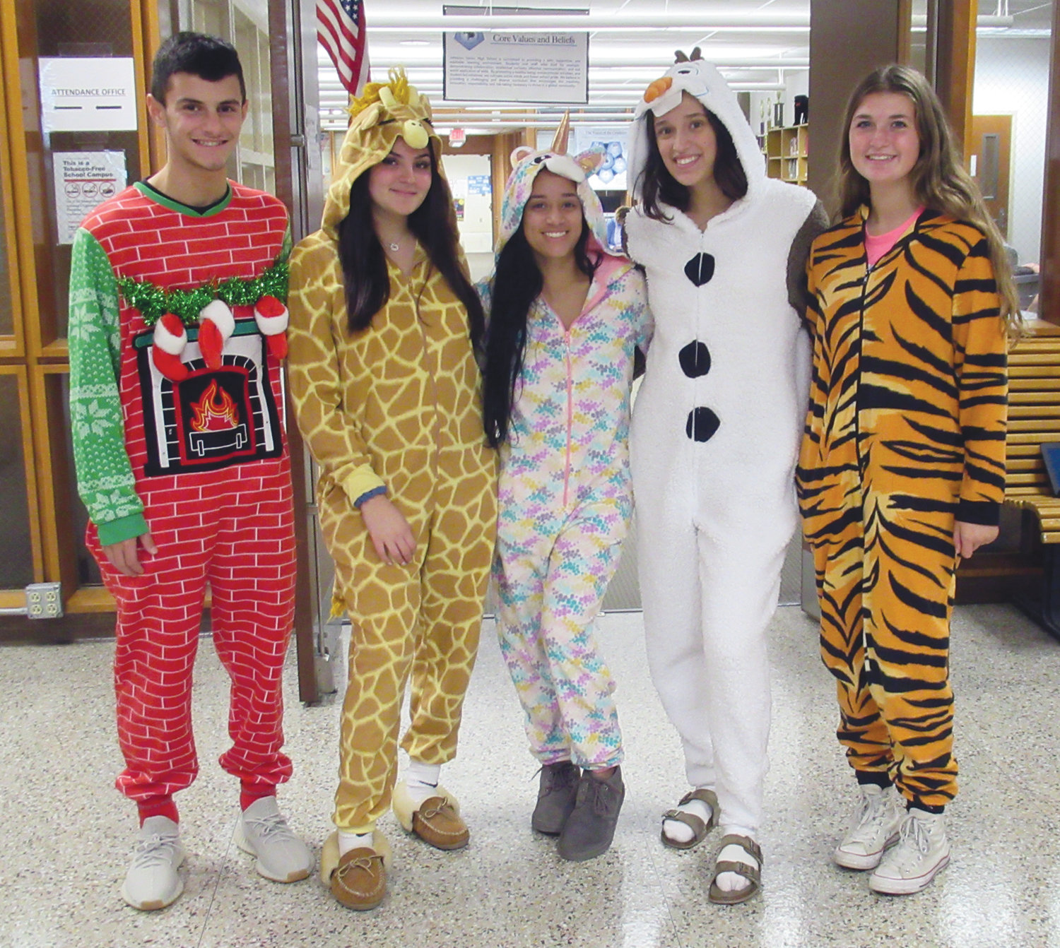 SUPER SPIRITS: Among the dozens of Johnston High School students who came to school sporting classic costumes for Tuesday's Onesie Day were, from left, Joey LaVallee, Angelina Emerson, Emicely Rodriguez, Olivia Costa and Delaney LaRose.
