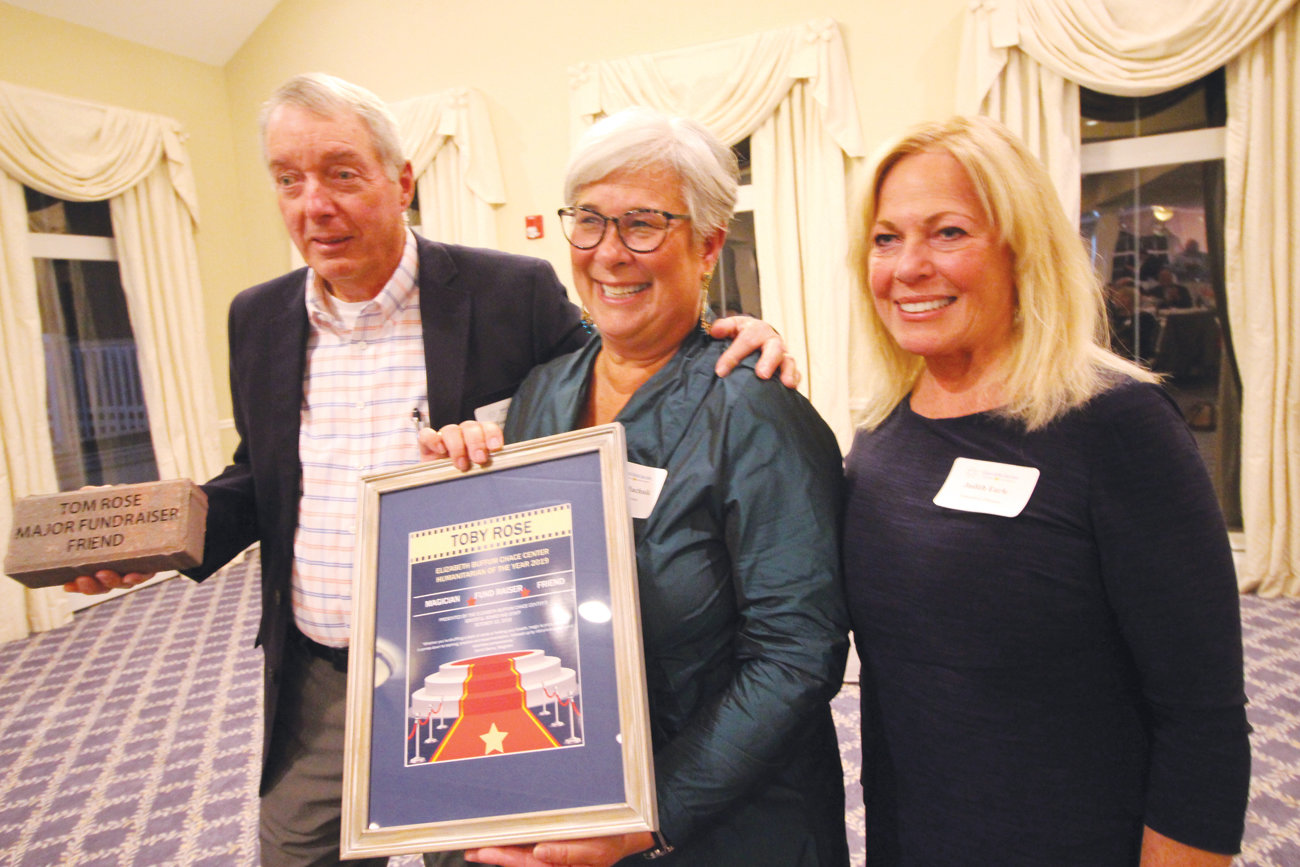 NEW AWARD: EBC Center board chair Martha Machnik, flanked by Toby Rose and Judith Earle, announces the newly established Toby Rose Humanitarian Award at Thursday night's event.