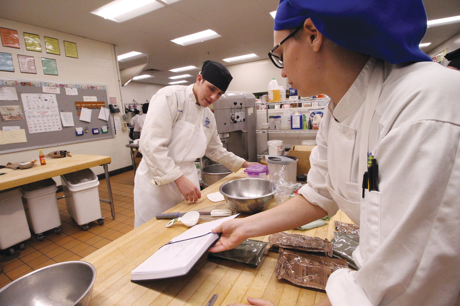 DESSERT IN THE MAKING: Using the contents of a military MRE, Warwick Area Career and Technical Center culinary students Brendon Rios and Isabella Wright made an apple trifle.