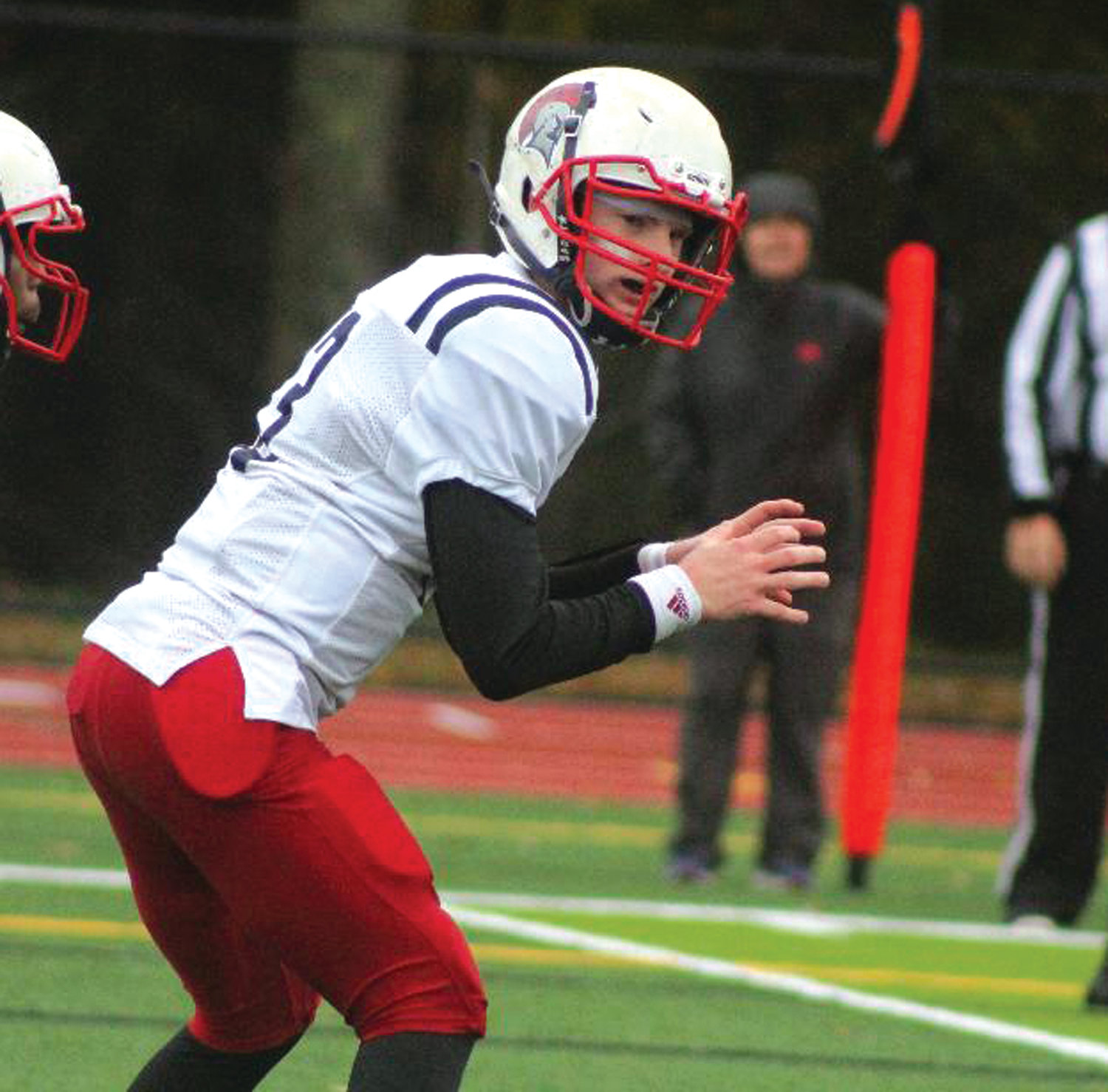 CALLING THE SHOTS: Toll Gate quarterback Greyson Pasquina in the backfield against Scituate.