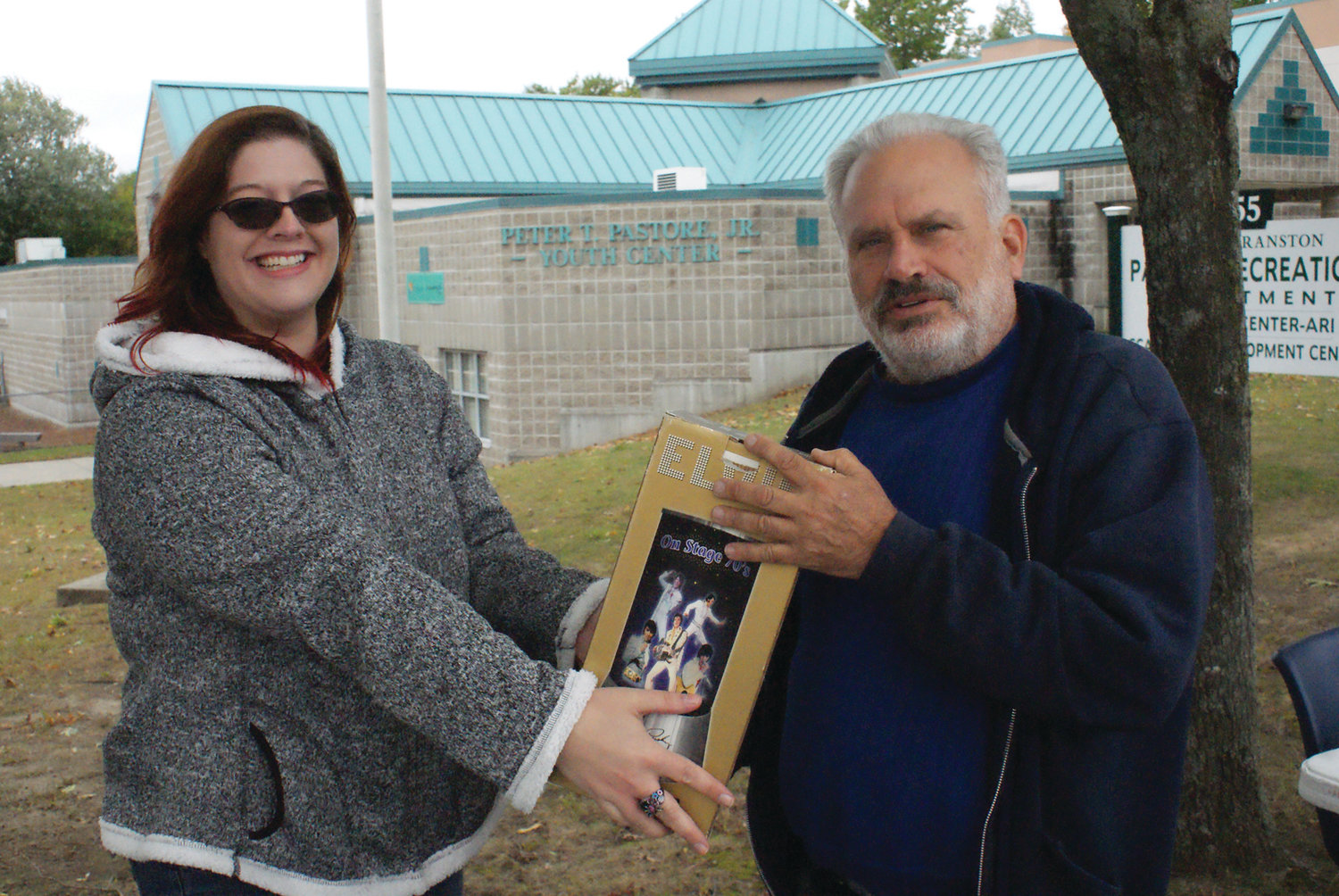 FINAL SALE: During the Cranston YMCA Yard Sale over the weekend, Heather Velzis sold her Elvis lamp to Cranston resident Philip Wexler.