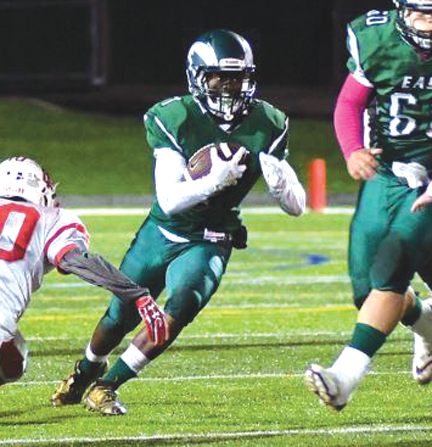 UP THE GUT: Cranston East running back Andrew Amoako takes a carry up the middle for the Thunderbolts last week at Cranston Stadium. East fell to visiting East Providence 39-0 to fall to 0-4 on the season. The Thunderbolts will now hit the road to take on the Bishop Hendricken Hawks on Friday evening.