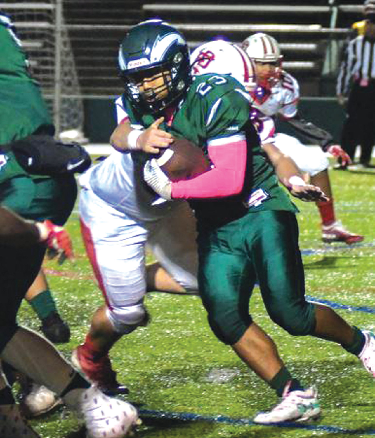 BREAKING TACKLES: Cranston East's Terrence Souvannasing works through East Providence defenders last week at Cranston Stadium during the team's 39-0 loss.