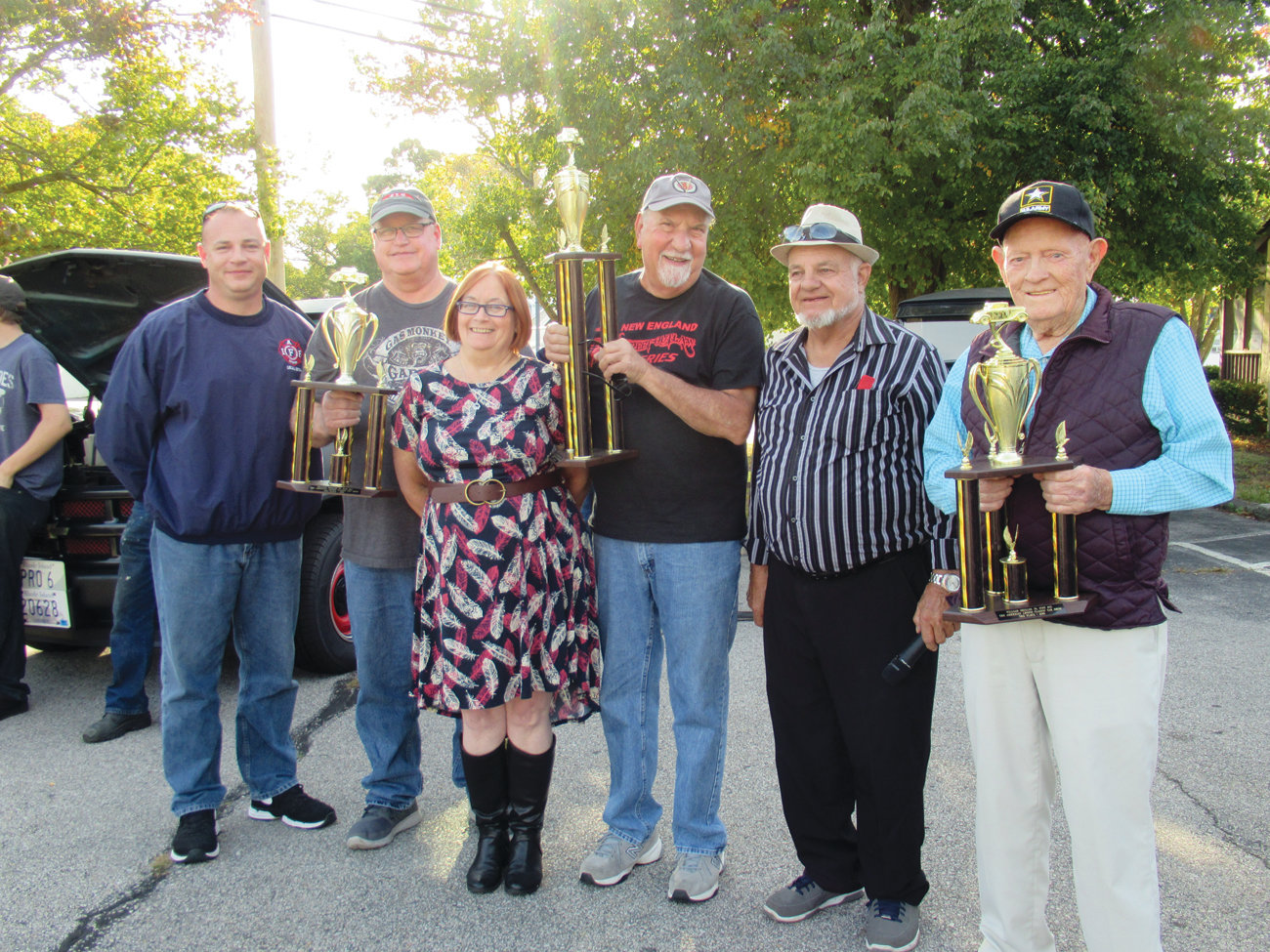 LEGION LINK: Betty Leach (third from left) is all smiles after she presented trophies to the top three winners in Sunday's Shields Post American Legion Car Show. The group includes from left: Troy Zillick, second place winner Bob Ray, first place winner Richard Cicchetti, Gene Cahoon and third place winner Joe Flamand.